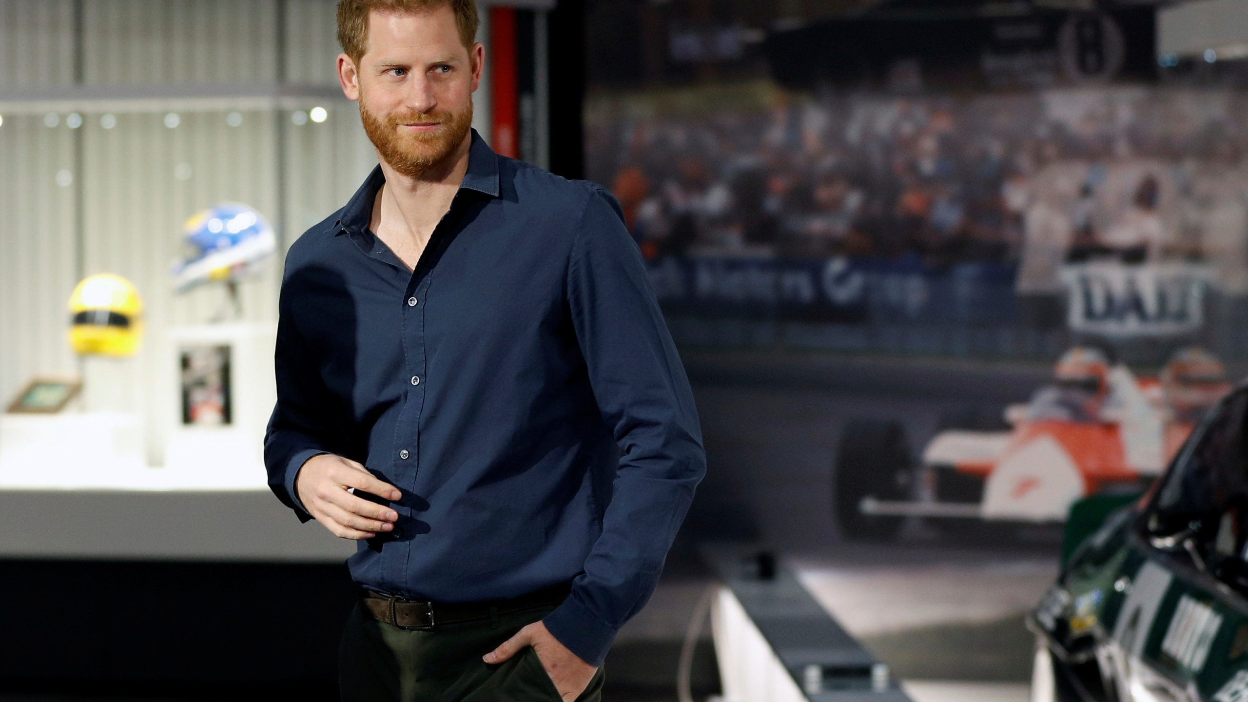 "In this Friday March 6, 2020, file photo, Britain's Prince Harry visits the Silverstone Circuit, in Towcester, England. In an episode of the ""Armchair Expert"" podcast broadcast Thursday, May 13, 2021, Prince Harry compared his royal experience to being on ""The Truman Show"" and ""living in a zoo."" (Peter Nicholls/Pool Photo via AP, File)"