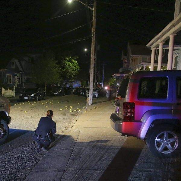Providence police investigate a shooting on May 13, 2021, in Providence, R.I. (Stew Milne / Associated Press)