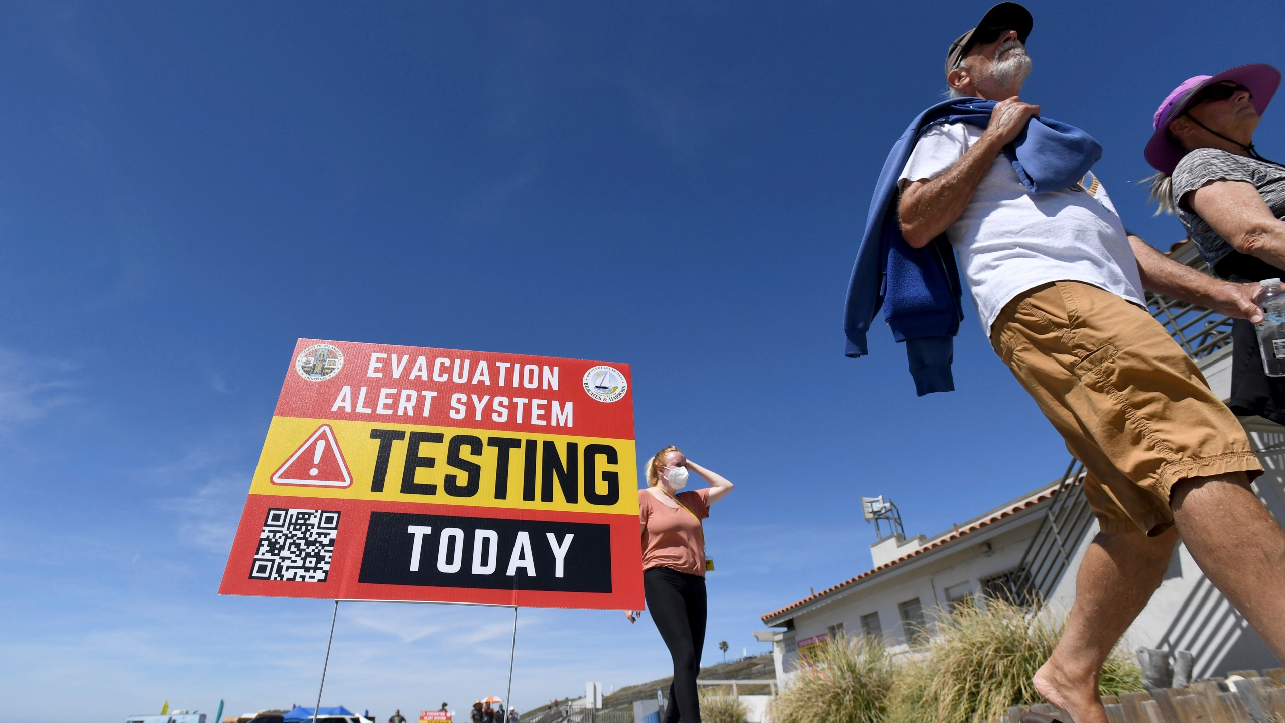 A testing sign for a new beach evacuation alert system is displayed Torrance Beach in Torrance, Calif., on Thursday, April 29, 2021. (Brittany Murray/The Orange County Register via AP)