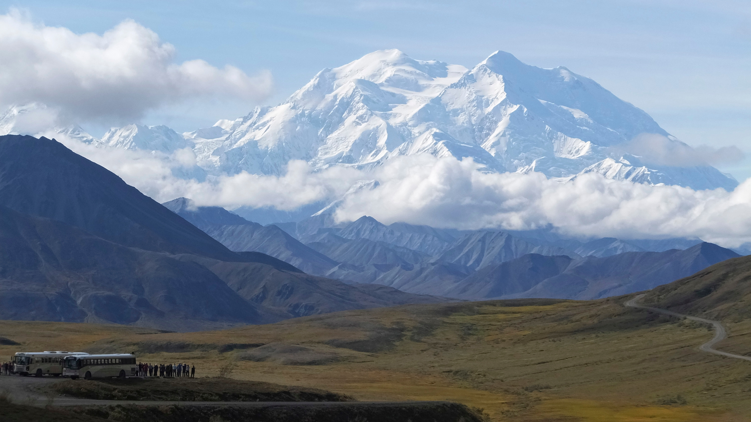 In this Aug. 26, 2016, file photo sightseeing buses and tourists are seen at a pullout popular for taking in views of North America's tallest peak, Denali, in Denali National Park and Preserve, Alaska. (AP Photo/Becky Bohrer, File)
