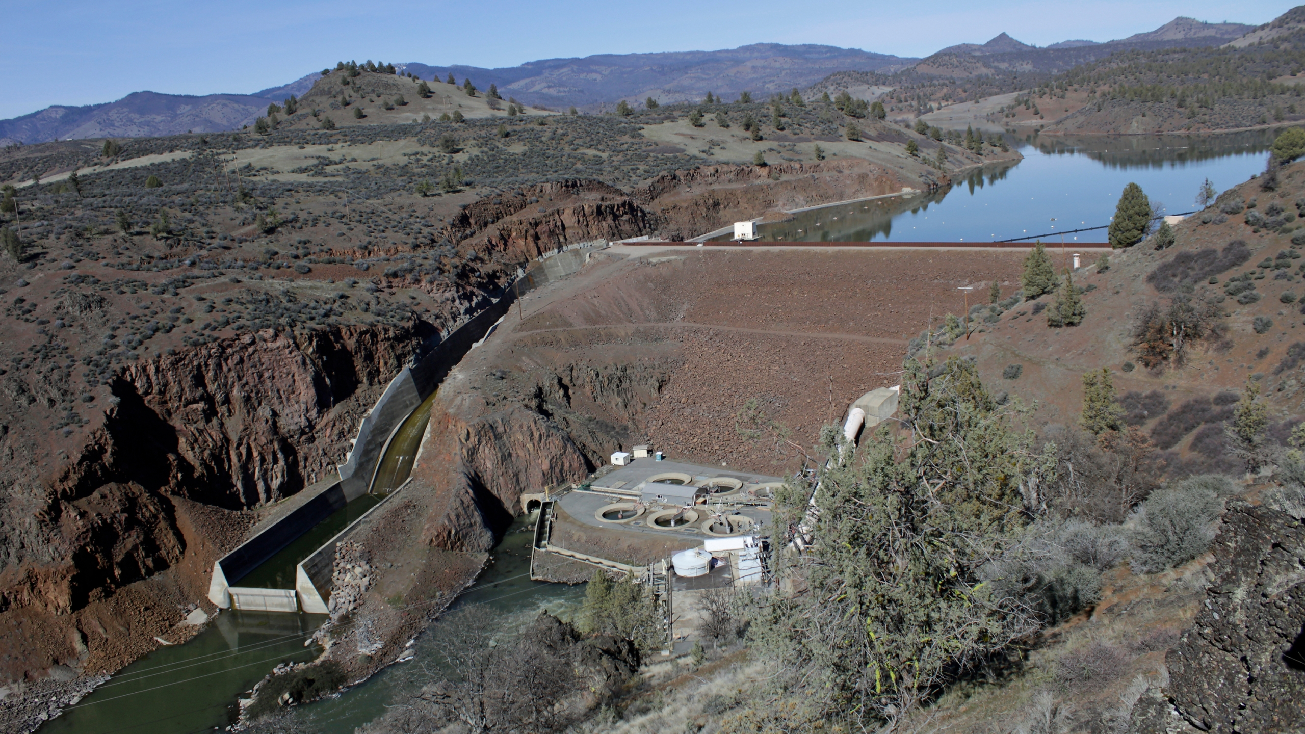 In this March 3, 2020, file photo, is the Iron Gate Dam, powerhouse and spillway are on the lower Klamath River near Hornbrook, Calif. (AP Photo/Gillian Flaccus, File)
