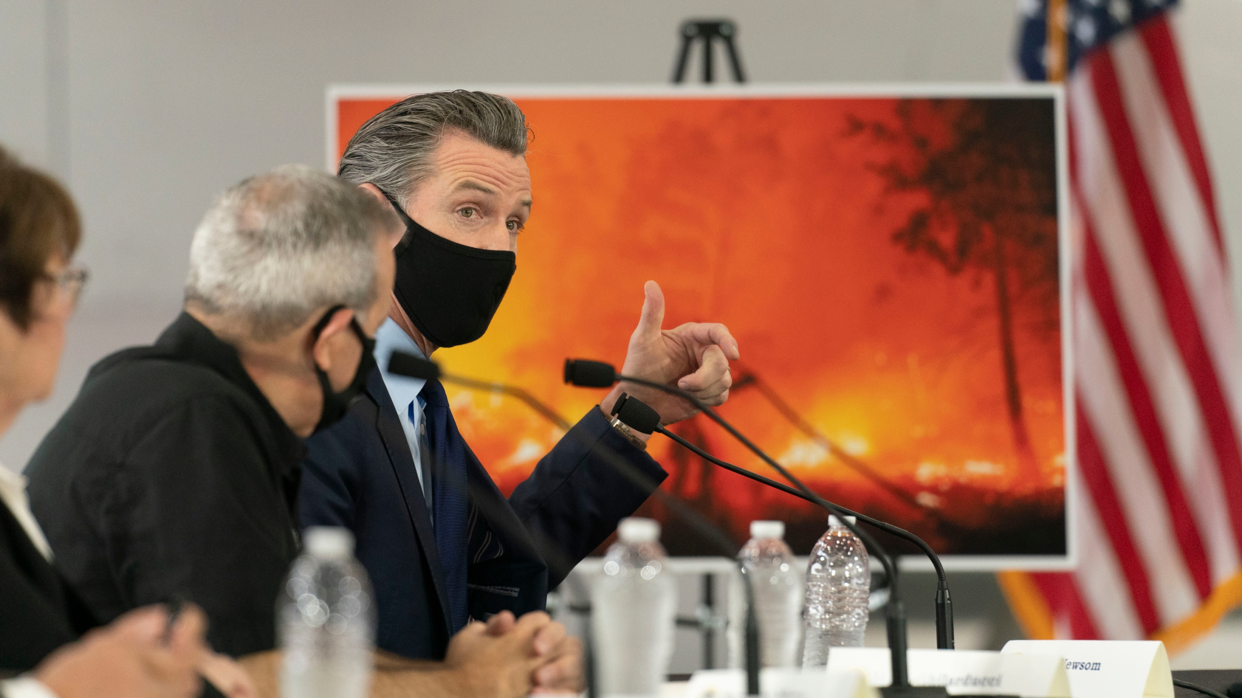 California Gov. Gavin Newsom speaks about wildfires during a briefing with then President Donald Trump at Sacramento McClellan Airport in McClellan Park, Calif., on Sept. 14, 2020. (Andrew Harnik / Associated Press)