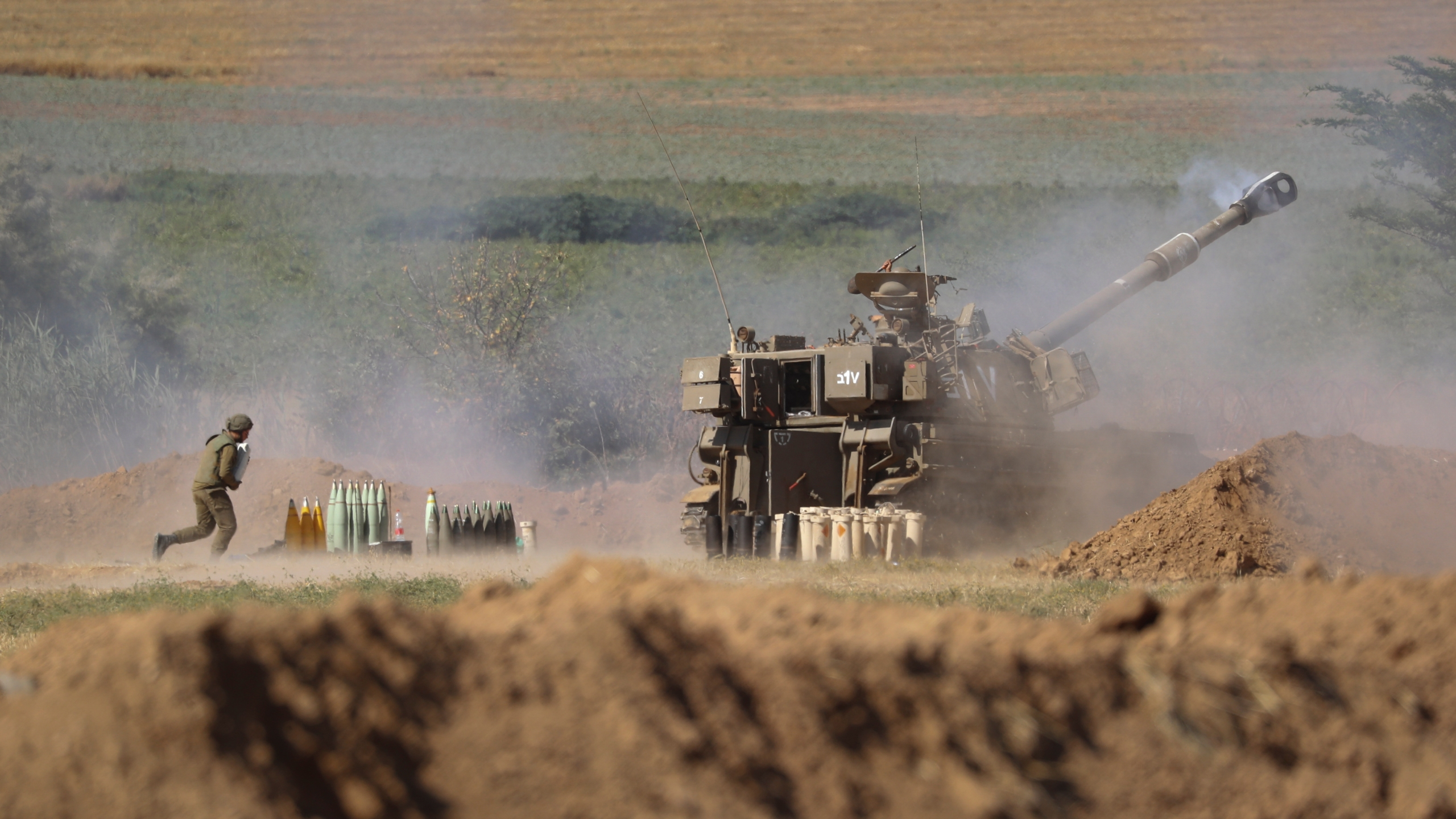 An Israeli artillery unit fires toward targets in the Gaza Strip, at the Israel-Gaza border, Saturday, May 15, 2021. (AP Photo/Ariel Schalit)