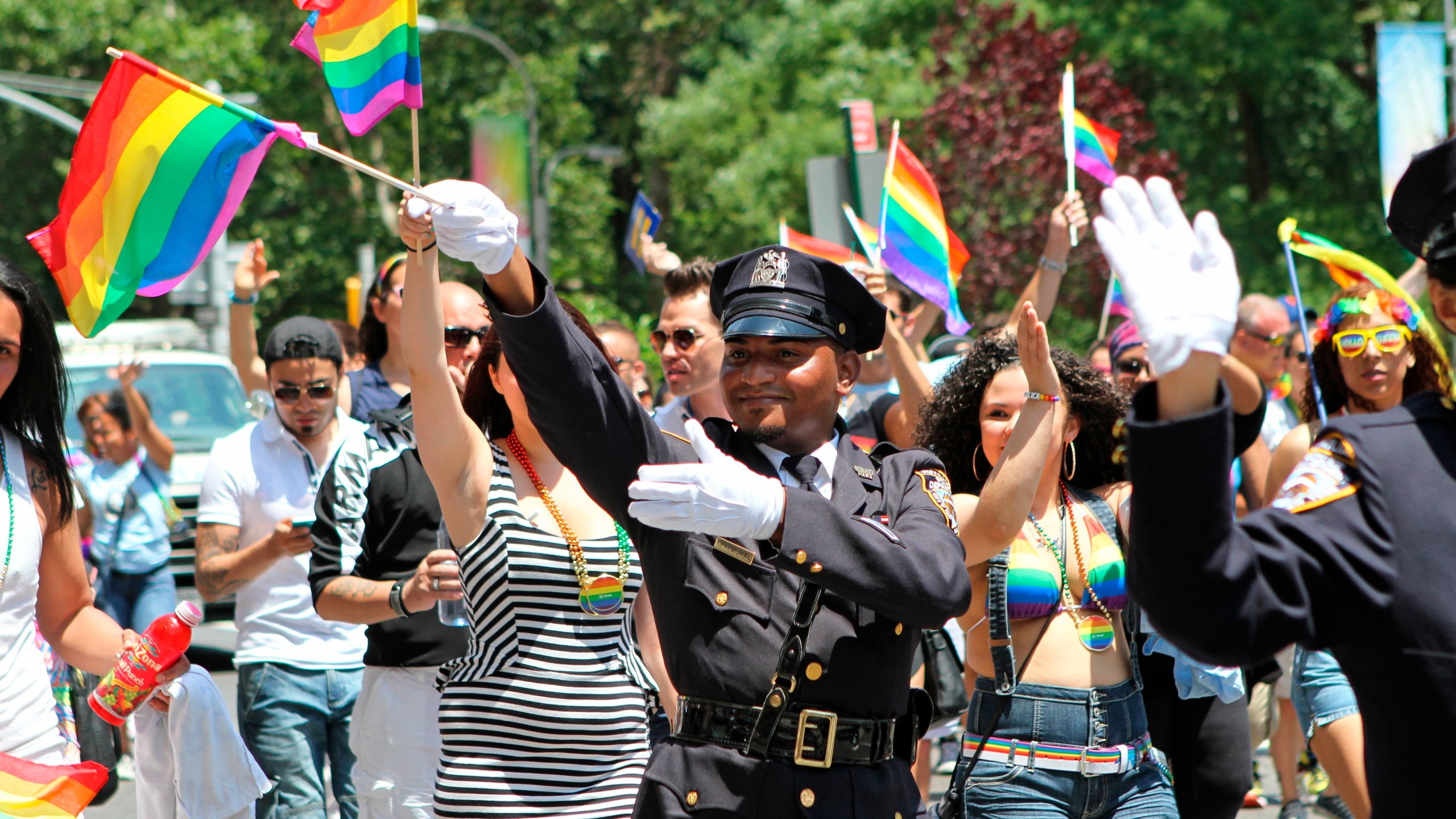 In this Sunday, June 29, 2014 file photo, NYPD police officers march along Fifth Avenue during the gay pride parade in New York. Organizers of New York City's Pride events said Saturday, May 15, 2021 they are banning police and other law enforcement from marching in their huge annual parade until at least 2025 and will also seek to keep on-duty officers a block away from the celebration of LGBTQ people and history. (AP Photo/Julia Weeks, File)