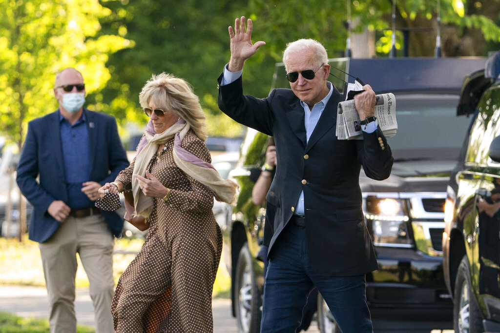 President Joe Biden with first lady Jill Biden waves as they walk on the Ellipse near the White House in Washington to board the Marine One, Saturday, May 15, 2021. (AP Photo/Manuel Balce Ceneta)