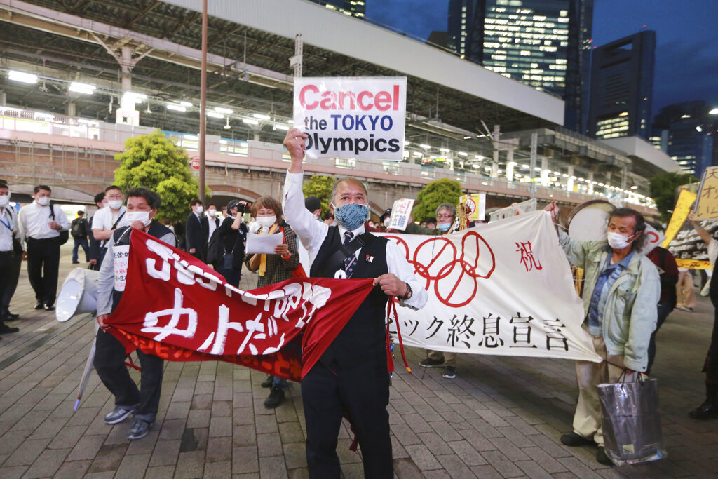 In this May 17, 2021, file photo, demonstrators protest against the Tokyo 2020 Olympics in Tokyo. (AP Photo/Koji Sasahara, File)