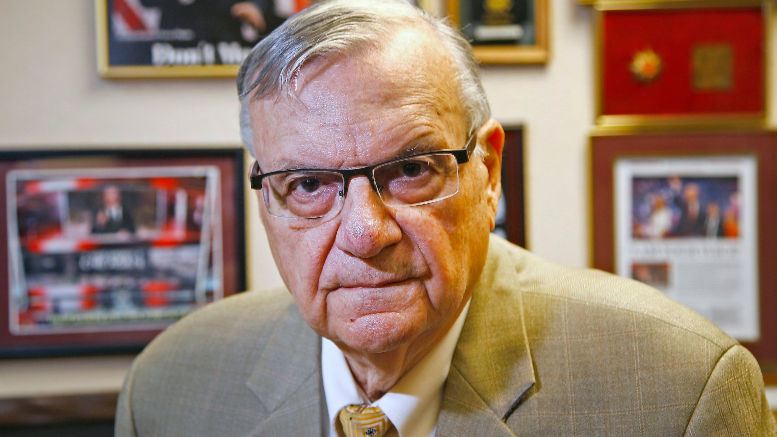 In this Aug. 26, 2019, file photo, former Maricopa County Sheriff Joe Arpaio poses for a portrait at his private office in Fountain Hills, Arizona. The taxpayer costs for the racial profiling lawsuit stemming from the immigration patrols launched a decade ago by Arpaio are expected to reach $202 million by the summer of 2022. Officials approved a tentative county budget Monday, May 17, 2021, that provides $31 million for compliance costs in the fiscal year that begins on July 1. No one in county government can say exactly when those costs will start to decline or end. (AP Photo/Ross D. Franklin, File)