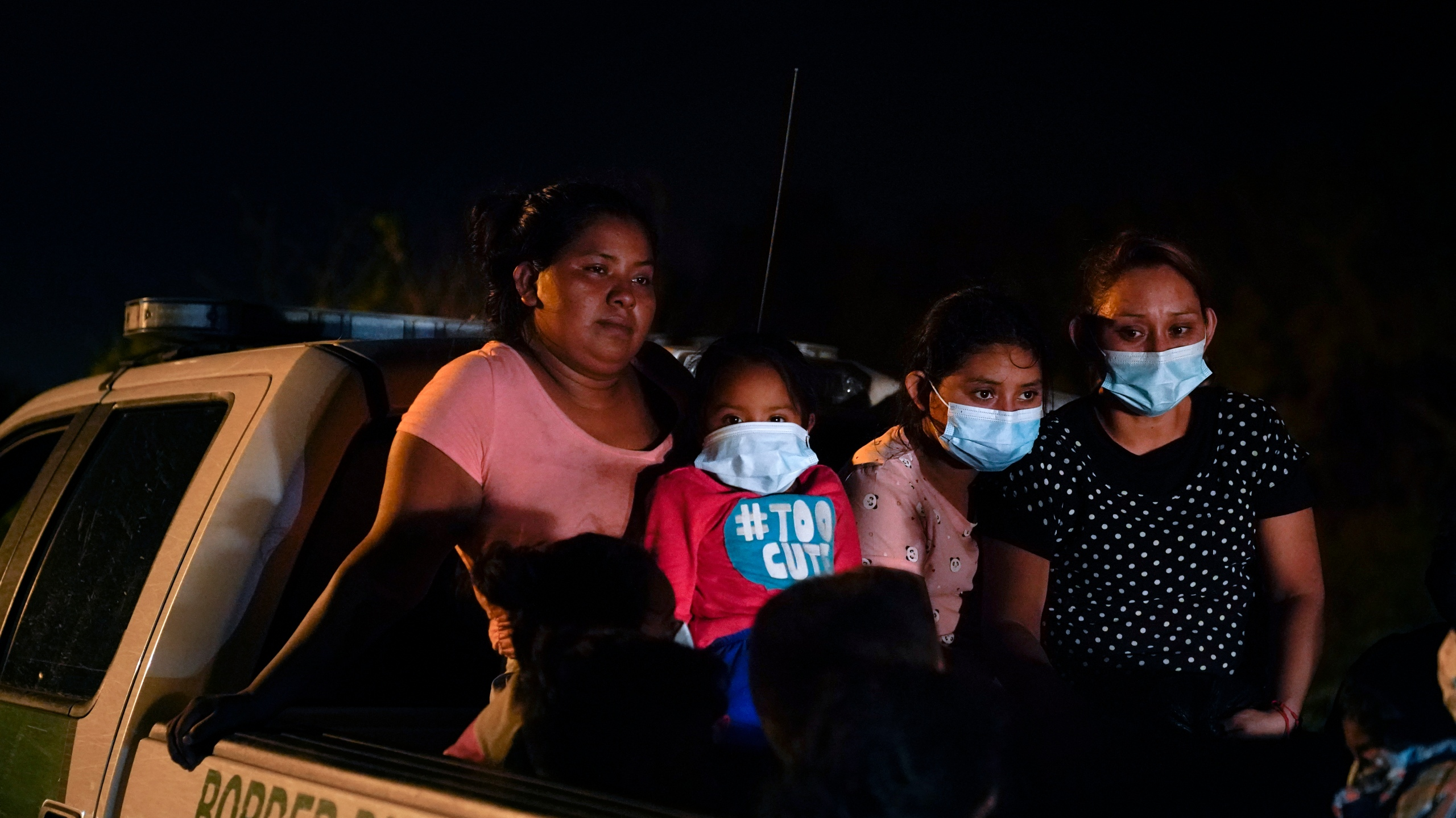 Migrants from Honduras wait in a Border Patrol truck after turning themselves in upon crossing the U.S.-Mexico border in La Joya, Texas, on May 17, 2021. (Gregory Bull / Associated Press)