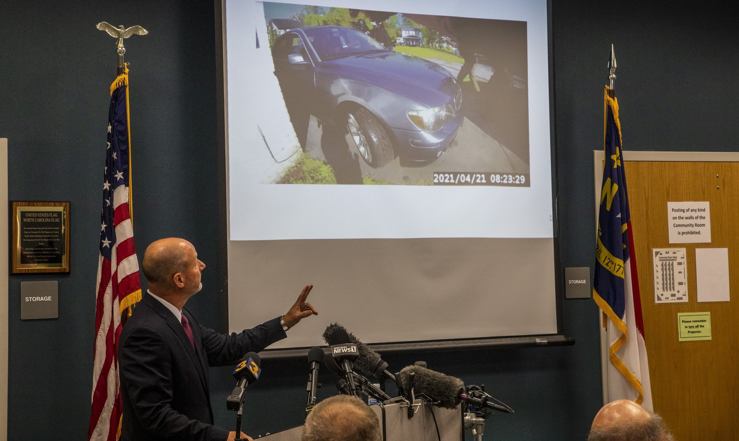 Pasquotank County District Attorney Andrew Womble shows still images from police body camera footage after announcing he will not charge deputies in the April 21 fatal shooting of Andrew Brown Jr. during a news conference Tuesday, May 18, 2021 at the Pasquotank County Public Safety building in Elizabeth City, N.C. Womble said he would not release bodycam video of the confrontation between Brown, a Black man, and the law enforcement officers. (Travis Long/The News & Observer via AP)