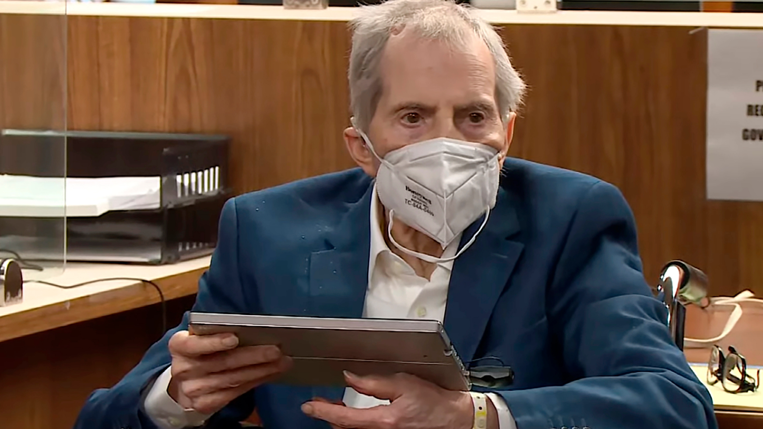 In this still image taken from the Law & Crime Network court video, real estate heir Robert Durst watches as Deputy District Attorney John Lewin presents a new round of opening statements in the murder case against Durst after a 14-month recess due to the coronavirus pandemic in Los Angeles County Superior Court in Inglewood on May 18, 2021. (Law & Crime Network via Associated Press, Pool)