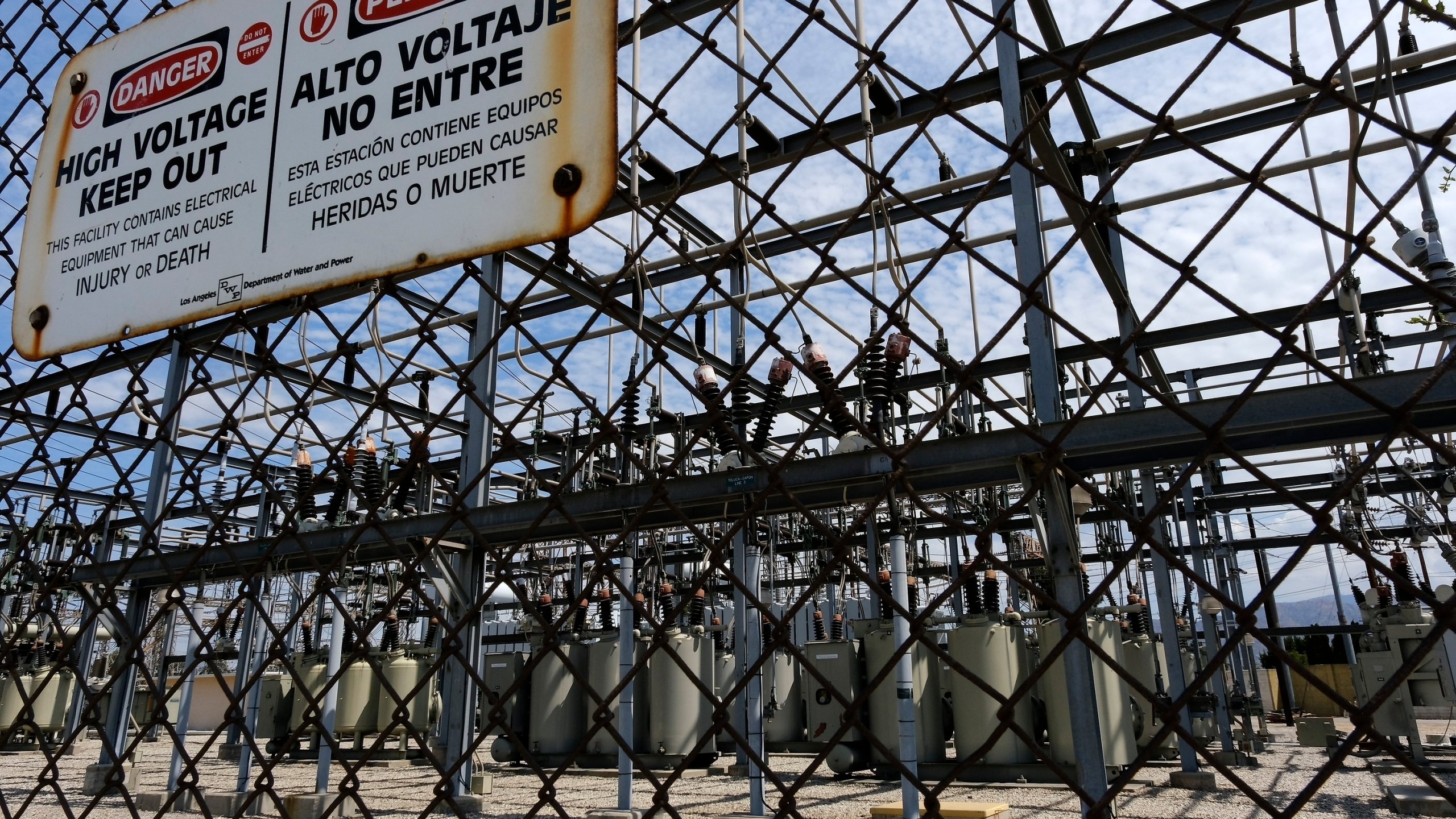 In this Aug. 15, 2020 file photo high voltage signs are posted on the Department of Water and Power Sub Station E in North Hollywood. (Richard Vogel/Associated Press)