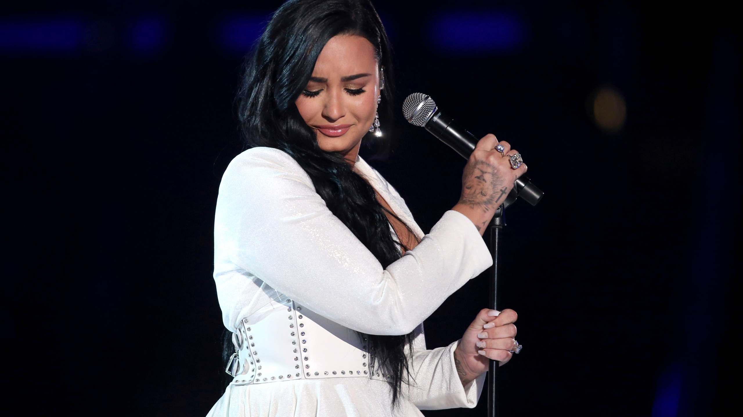 """Demi Lovato performs """"Anyone"""" at the 62nd annual Grammy Awards on Jan. 26, 2020, in Los Angeles. Lovato revealed on May 19, 2021 they identify as nonbinary and are changing their pronouns, telling fans the decision came after """"self-reflective work."""" (Matt Sayles/Invision/AP, File)"""