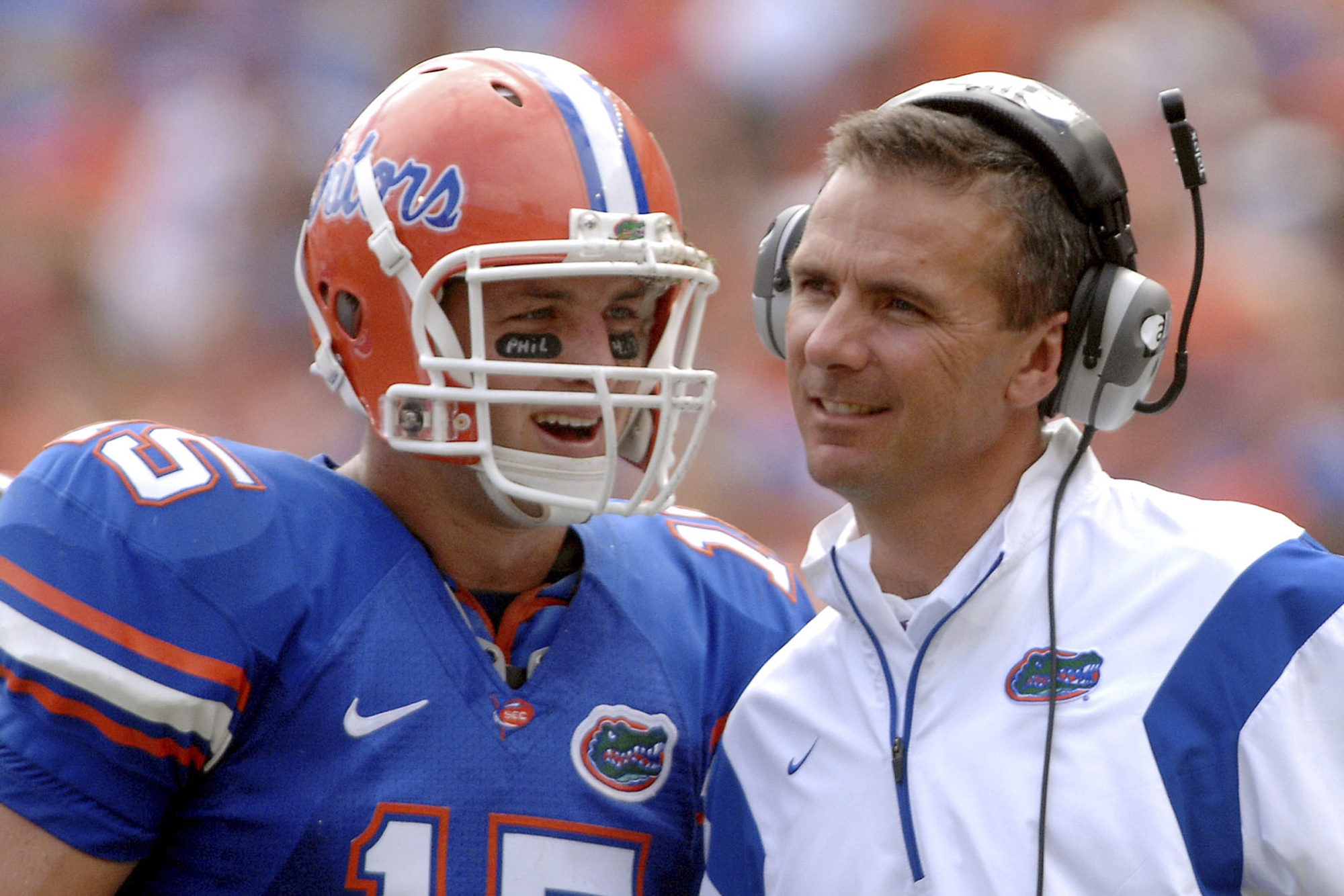 In this Oct. 25, 2008, file photo, Florida quarterback Tim Tebow (15) shares a laugh with coach Urban Meyer during the fourth quarter of an NCAA college football game against Kentucky in Gainesville, Fla. Tebow and Meyer are together again, this time in the NFL and with Tebow playing a new position. The former Florida star and 2007 Heisman Trophy-winning quarterback signed a one-year contract with the Jacksonville Jaguars on Thursday, May 20, 2021, and will attempt to revive his pro career as a tight end. (AP Photo/Phil Sandlin, File)