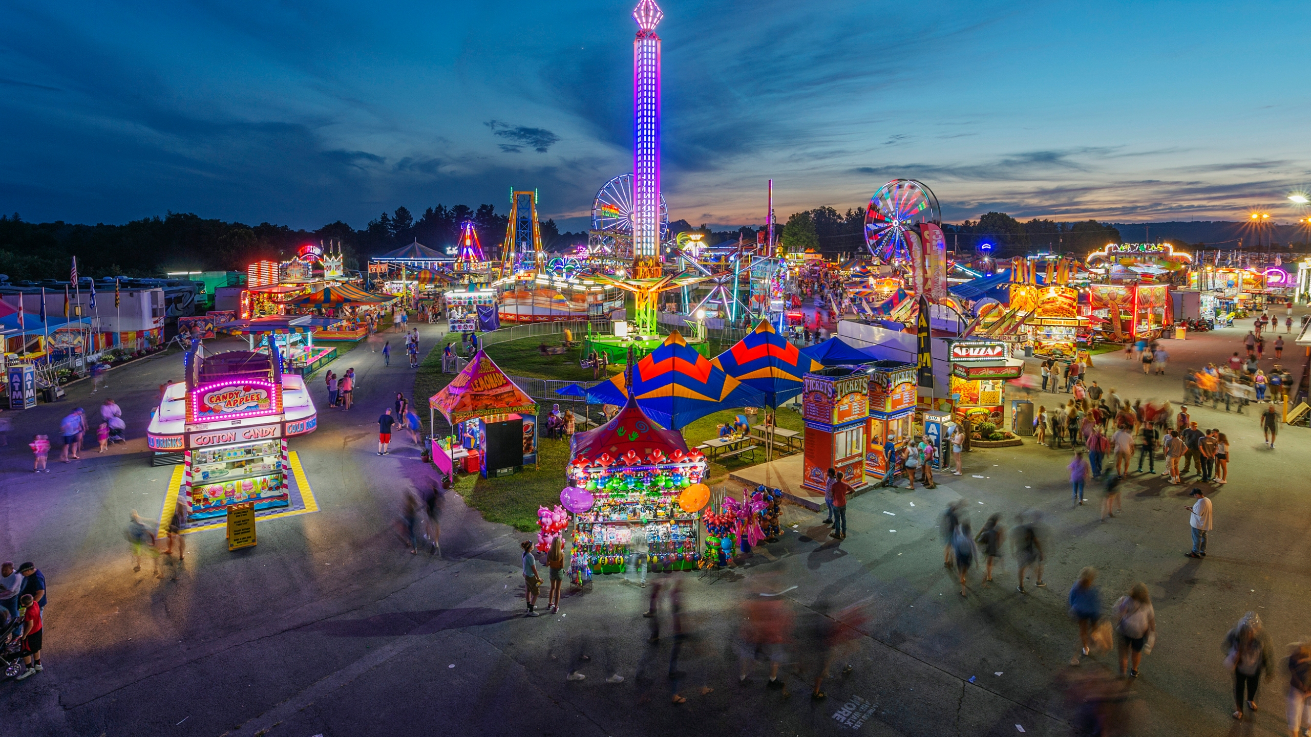 In this Aug. 9, 2018, file photo, fair-goers attend The State Fair of West Virginia at the State Fairgrounds in Fairlea, W.Va. West Virginia has seen a higher percentage of residents depart than any other state in the past decade. (Craig Hudson/Charleston Gazette-Mail via AP, File)