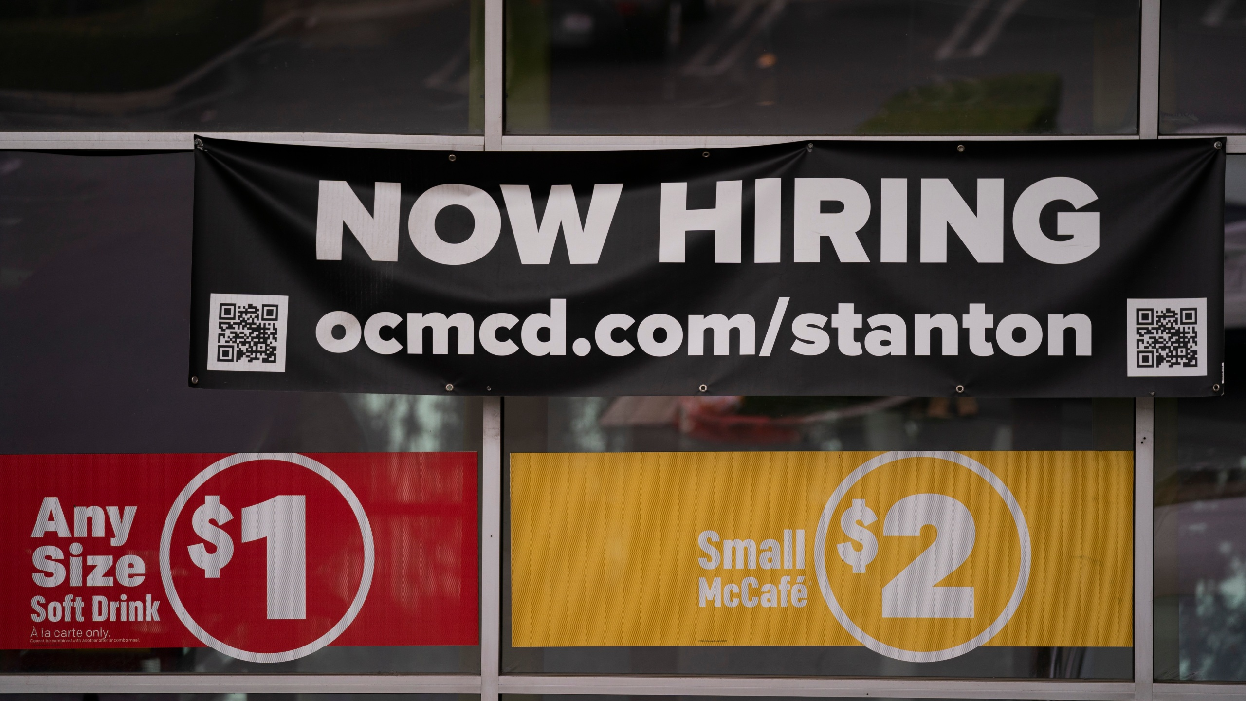 In this May 17, 2021, file photo, a hiring banner hangs outside a McDonald's fast-food restaurant in Stanton, Calif. (AP Photo/Jae C. Hong, File)