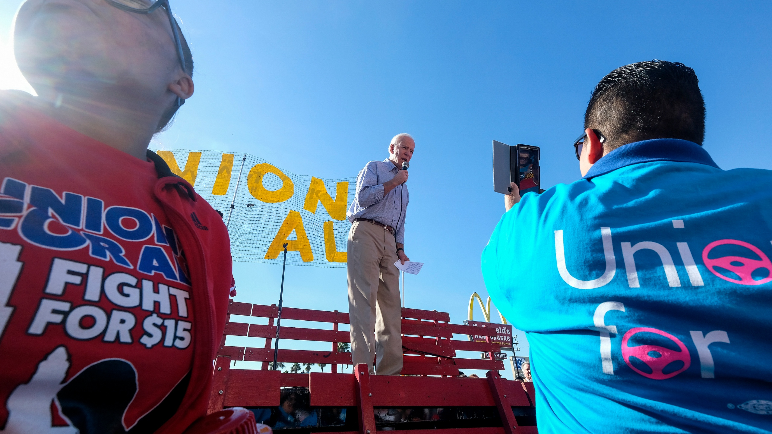 In this Dec. 19, 2019, file photo Democratic presidential candidate former Vice President Joe Biden, speaks at a rally in support of McDonald's cooks and cashiers who are demanding higher wages and union rights, outside a McDonald's restaurant in Los Angeles. (AP Photo/Ringo H.W. Chiu, File)