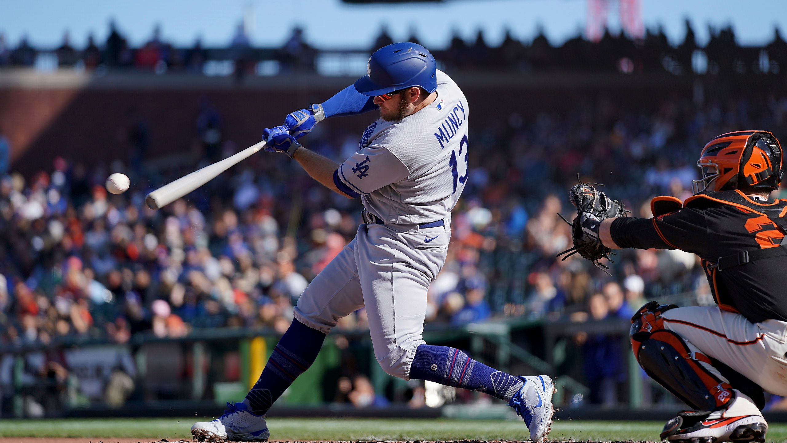 Los Angeles Dodgers' Max Muncy (13) hits a single against the San Francisco Giants during the fourth inning of a baseball game Saturday, May 22, 2021, in San Francisco. (AP Photo/Tony Avelar)