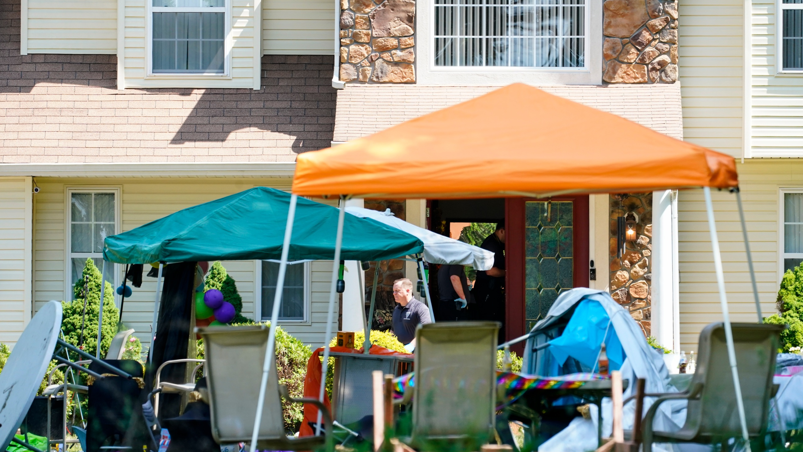Investigators works the scene of a shooting in Fairfield Township, N.J., Sunday, May 23, 2021. (AP Photo/Matt Rourke)