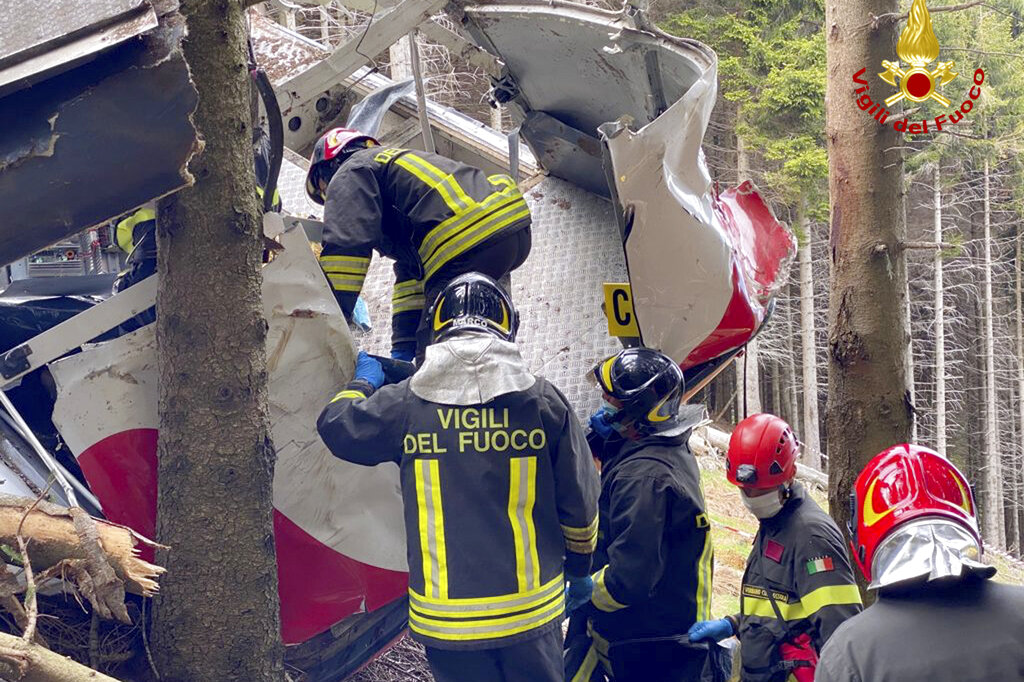 Rescuers work by the wreckage of a cable car after it collapsed near the summit of the Stresa-Mottarone line in the Piedmont region, northern Italy, Sunday, May 23, 2021. (Vigili del Fuoco Firefighters via AP)