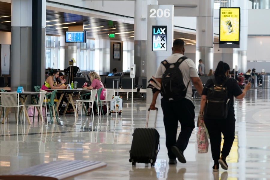 Passengers wait for their flights inside the new West Gates at Tom Bradley International Terminal at Los Angeles International Airport on May 24, 2021. (Ashley Landis / Associated Press)