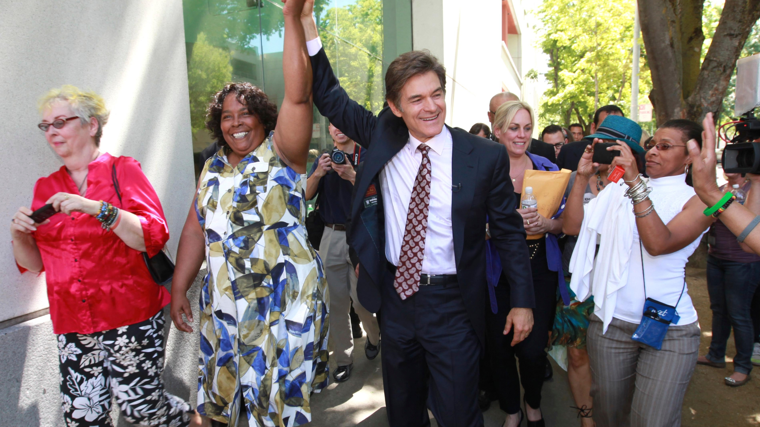 In this April 30, 2012, file photo, Yvonne Walker, president of the Service Employees International Union Local 1000, leads a walk for health with Dr. Mehmet Oz, in downtown in Sacramento, Calif. The president of California's largest state employees union has been ousted from the post she held for 13 years and replaced by a candidate who promises to end the organization's political involvement while bolstering its membership, according to results from a low-turnout election posted by the union. Under Walker's leadership since 2008, SEIU Local 1000 was a thorn in the side of the state's last Republican governor, Arnold Schwarzenegger, but grudgingly negotiated other austerity moves with his two Democratic successors. (AP Photo/Rich Pedroncelli, File)