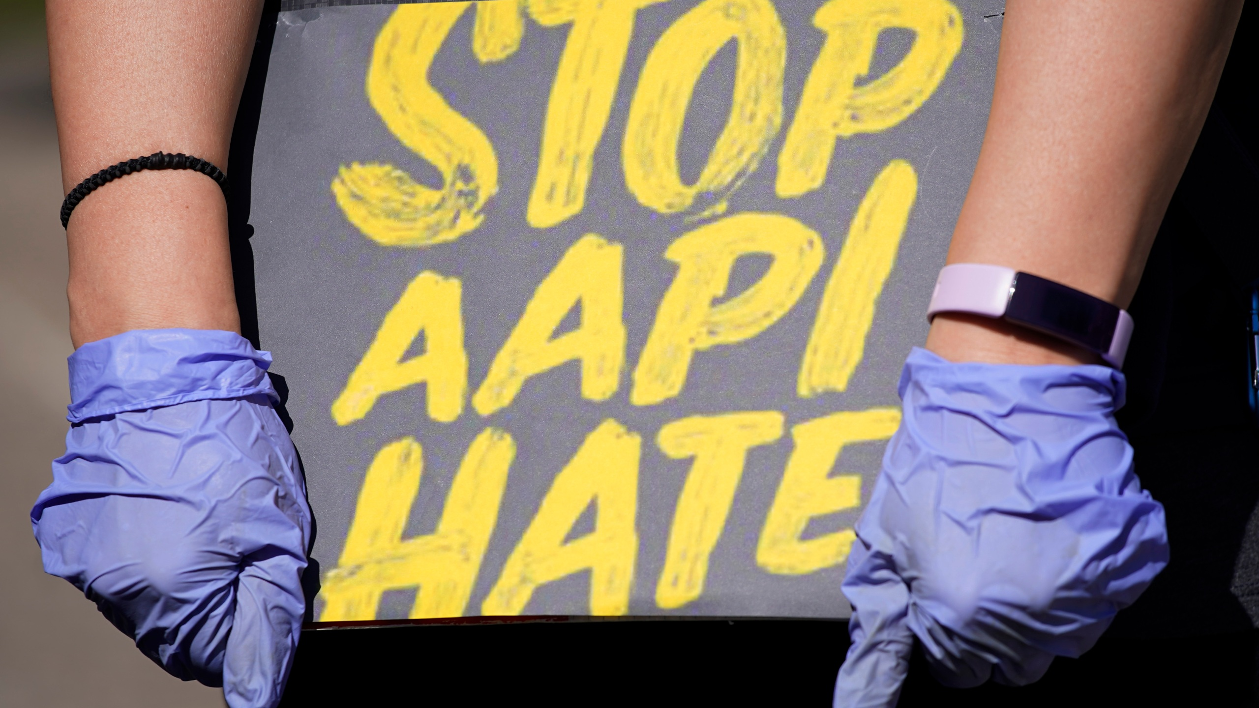In this March 20, 2021, file photo, woman holds a sign and attends a rally to support stop AAPI hate at the Logan Square Monument in Chicago. (Nam Y. Huh/Associated Press)