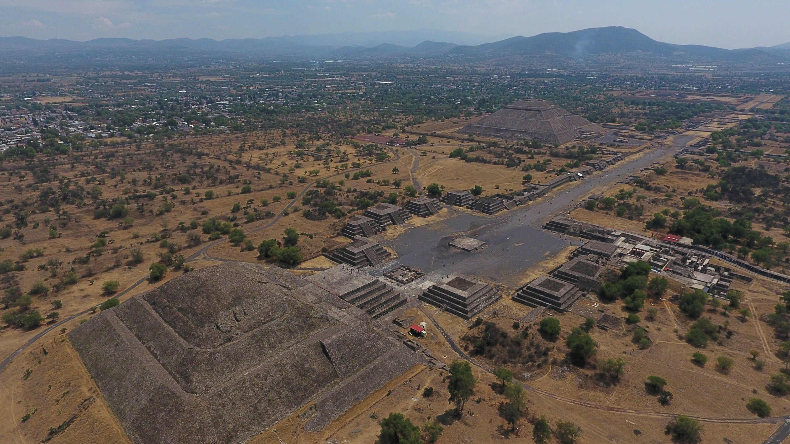 The Pyramid of the Moon, left, and the Pyramid of the Sun, back right, are seen along with smaller structures lining the Avenue of the Dead, in Teotihuacan, Mexico, on March 19, 2020. (Rebecca Blackwell / Associated Press)