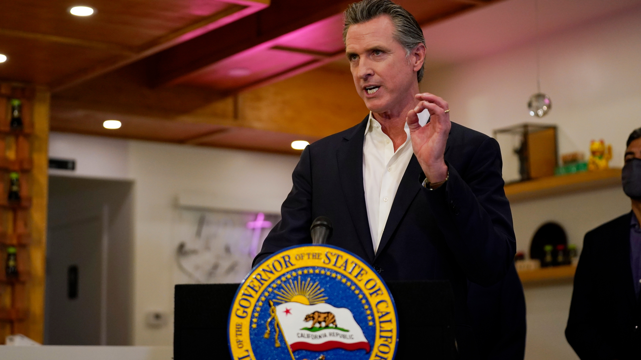 California Gov. Gavin Newsom speaks at Hanzo Sushi Thursday, April 29, 2021, in San Fernando, Calif. Businesses could be spared billions of dollars of higher taxes in coming years as a result of federal coronavirus relief funds flowing to the states. Newsom announced a budget plan this spring that would use $1.1 billion from the latest federal COVID-19 relief law to bolster a depleted unemployment compensation accounts. (AP Photo/Marcio Jose Sanchez, file)