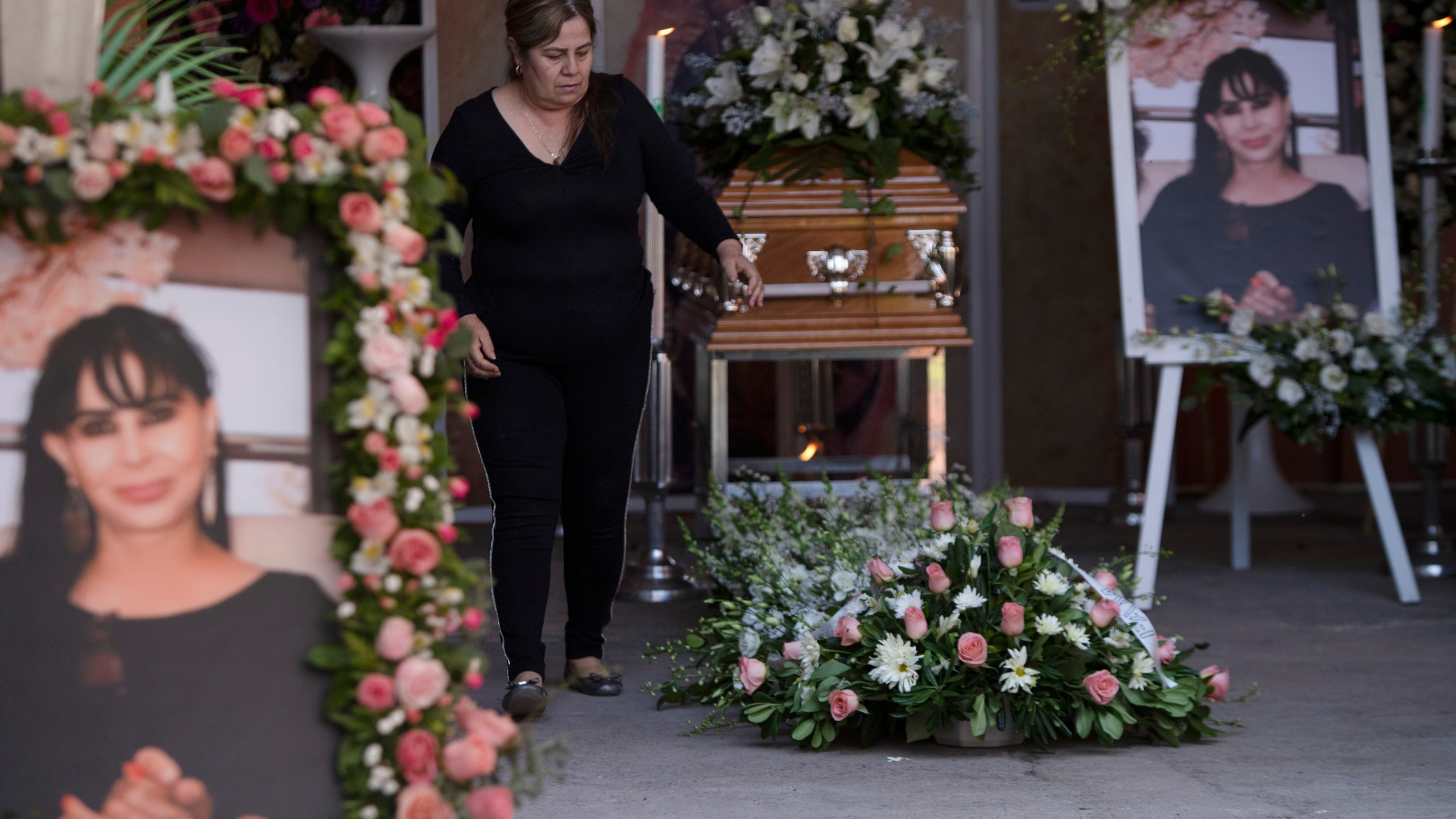 A woman attends the wake of mayoral candidate Alma Barragan in Moroleon, Mexico, on May 26, 2021. (Armando Solis / Associated Press)