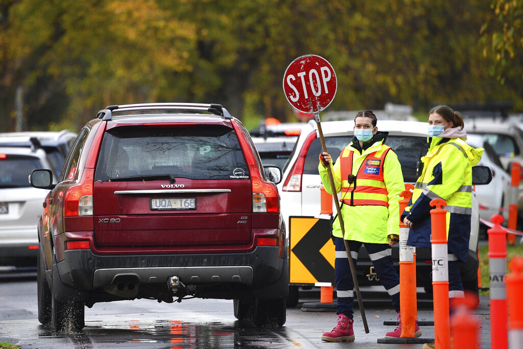 Traffic is controlled at a COVID-19 testing facility in Melbourne, Australia, Thursday, May 27, 2021, Australia's second largest city announced a seven-day lockdown on Thursday as concern grows over dozens of cases of a COVID-19 variant found in India. (James Ross/AAP Image via AP)