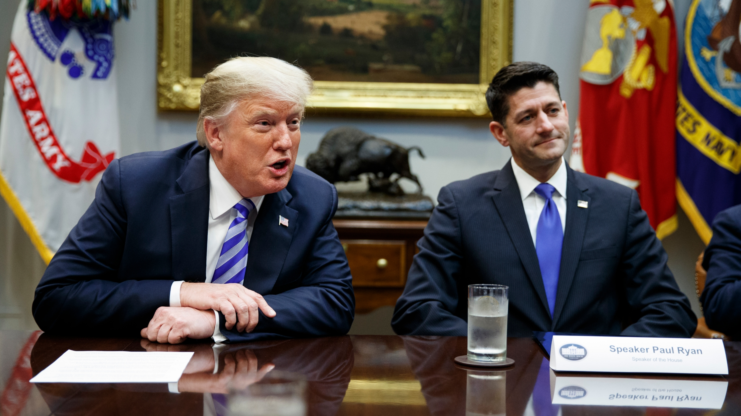 In this Sept. 5, 2018, file photo, then-Speaker of the House Paul Ryan, R-Wis., listens to President Donald Trump speak during a meeting with Republican lawmakers in the Roosevelt Room of the White House in Washington. (AP Photo/Evan Vucci, File)