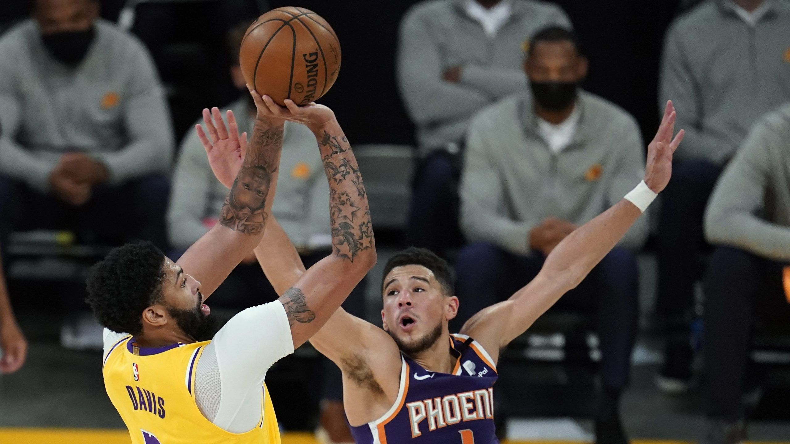 Los Angeles Lakers forward Anthony Davis shoots over Phoenix Suns guard Devin Booker during the first half in Game 3 of an NBA basketball first-round playoff series against the Phoenix Suns at Staples Center on May 27, 2021. (Marcio Jose Sanchez / Associated Press)