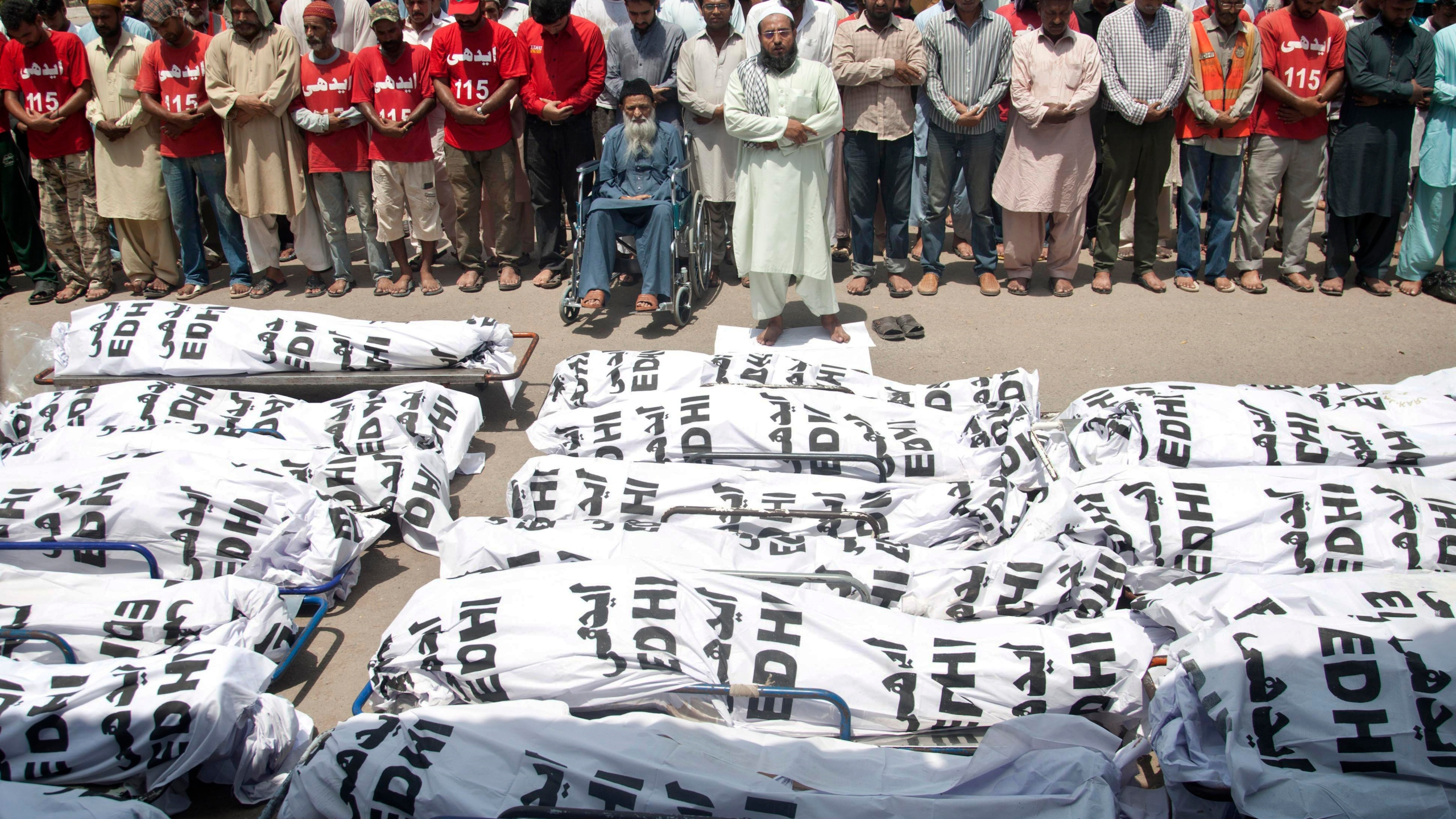 In this June 26, 2015 file photo, mourners attend a funeral for unclaimed people who died of extreme weather in Karachi, Pakistan after a devastating heat wave that struck southern Pakistan the previous weekend, with over 800 confirmed deaths according to a senior health official. A study published in Nature Climate Change on May 31, 2021, has calculated that more than one-third of global heat deaths can directly be attributed to human-caused climate change. (Shakil Adil/Associated Press)