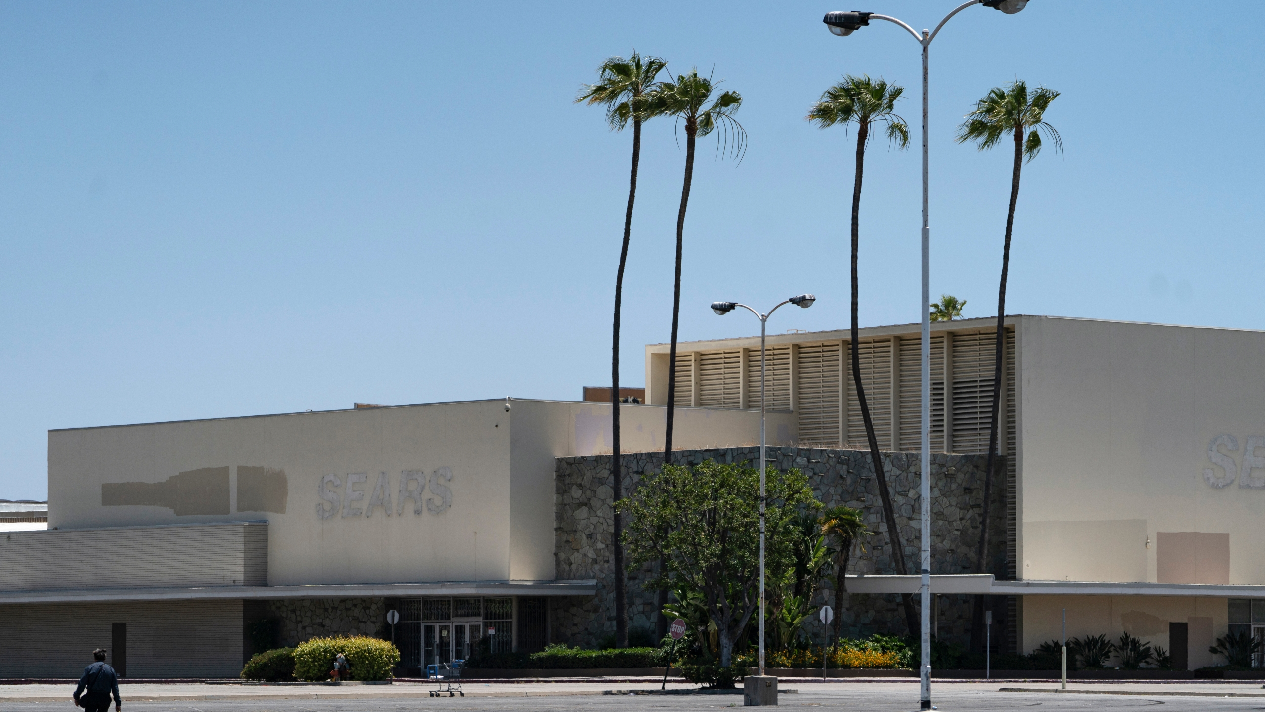 This Thursday, May 27, 2021, photo shows the closed Sears in Buena Park Mall in Buena Park, Calif. (AP Photo/Damian Dovarganes)