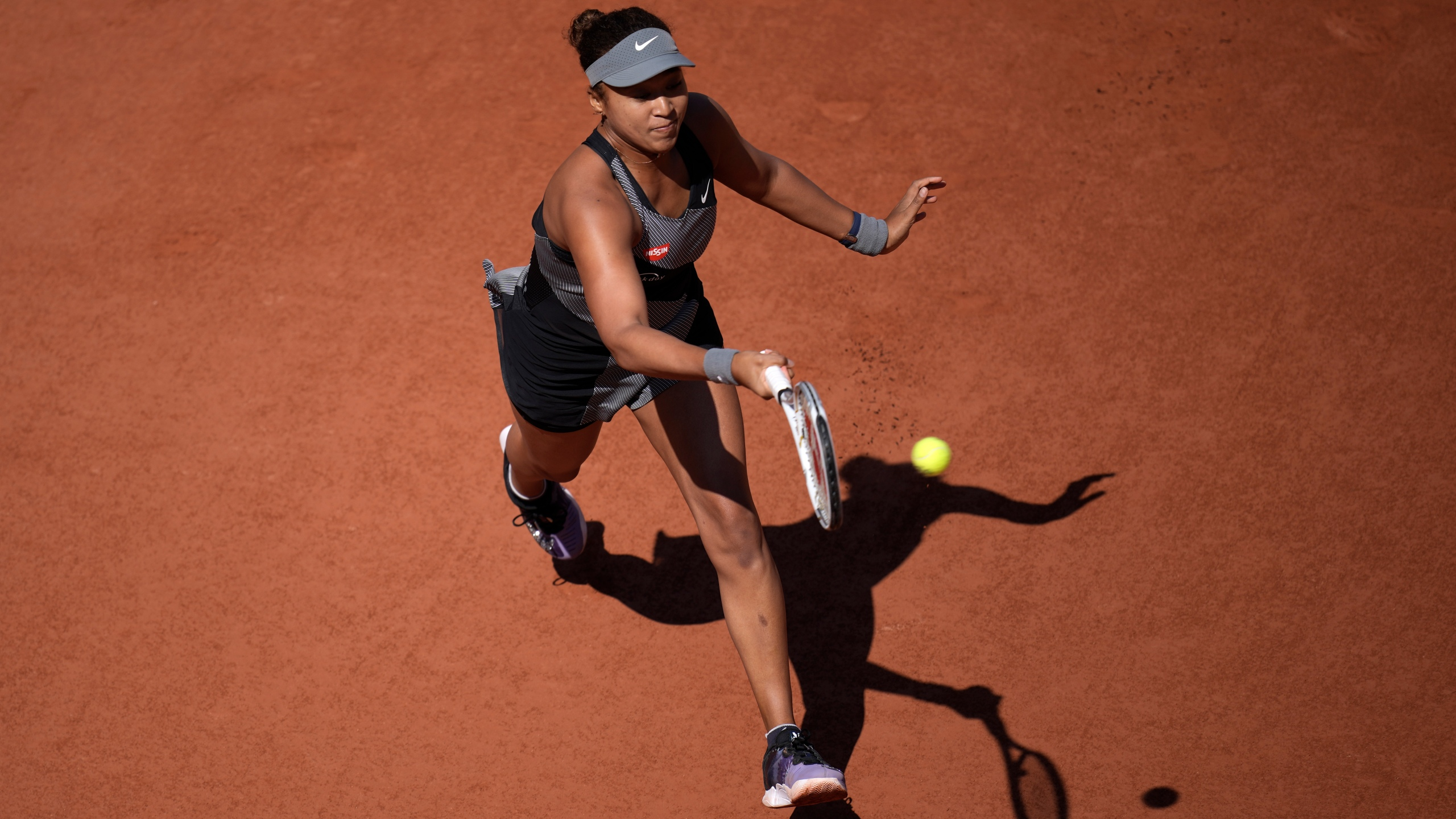Japan's Naomi Osaka returns the ball to Romania's Patricia Maria Tig during their first round match at the Roland Garros stadium on May 30, 2021 in Paris. (Christophe Ena/Associated Press)