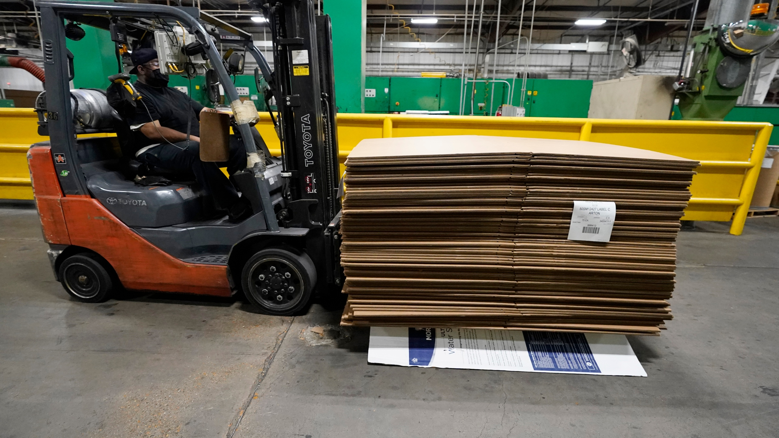 A forklift driver moves a pallet of cardboard boxes at Great Southern Industries, a packaging company in Jackson, Miss., says Friday, May 28, 2021. Charita McCarrol, human resources manager at the company, says that she has seen a lot of people abusing the $300-a-week federal supplement for people who lost their jobs during the COVID-19 pandemic, as well as other programs that offered extended support for the unemployed. She also cited the pool of needed certified and experienced forklift drivers and other positions are limited because of the said abuse. (AP Photo/Rogelio V. Solis)