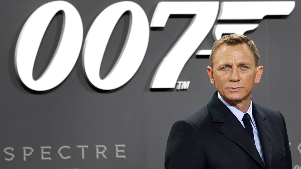 """In this Oct. 28, 2015, file photo, actor Daniel Craig poses for the media as he arrives for the German premiere of the James Bond movie 'Spectre' in Berlin, Germany. Amazon, on Wednesday, May 26, 2021, is buying MGM, the movie and TV studio behind James Bond, """"Legally Blonde"""" and """"Shark Tank,"""" with the hopes of filling its video streaming service with more stuff to watch. (AP Photo/Michael Sohn, File)"""