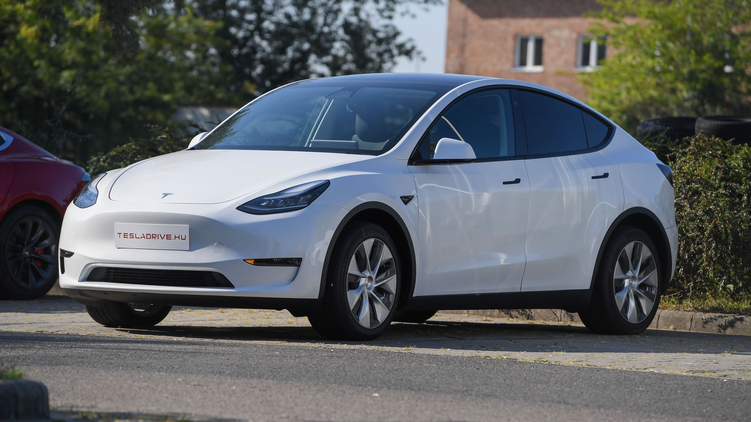 A Tesla Model Y car, an all-electric compact SUV, is seen during its presentation at the Automobile Club in Budapest on Sept. 5, 2020. (ATTILA KISBENEDEK / AFP / Getty Images)