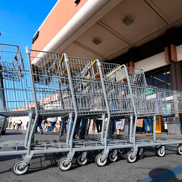 A Food 4 Less employee pushes carts in Long Beach on Feb. 3, 2021. (FREDERIC J. BROWN/AFP via Getty Images)