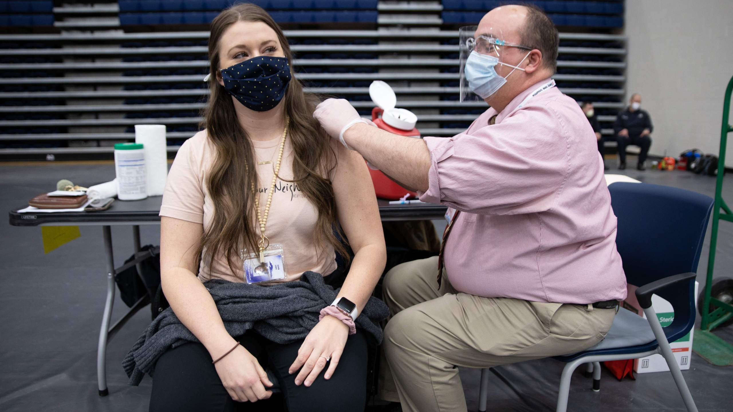 Educational staff at Kettering City Schools receive the COVID-19 vaccine as a part of Ohio's Phase 1B vaccine distribution in Dayton, Ohio, on Feb. 10, 2021. (MEGAN JELINGER/AFP via Getty Images)