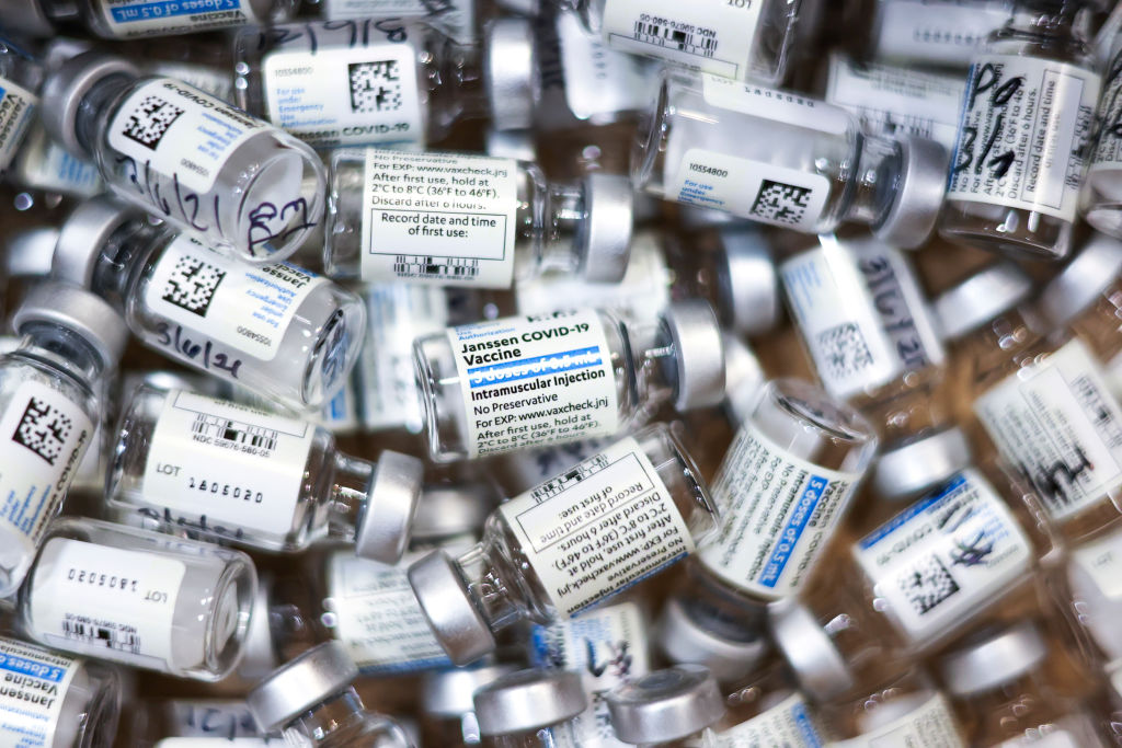 Used vials of the Johnson & Johnson COVID-19 vaccine sit in a box on March 6, 2021 in Thornton, Colorado. (Michael Ciaglo/Getty Images)