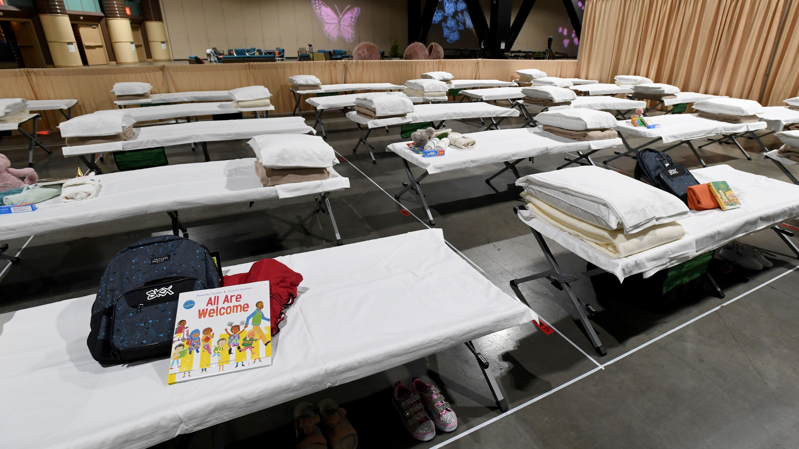 Sleeping quarters set up inside Exhibit Hall B for migrant children are shown during a tour of the Long Beach Convention Center on April 22, 2021. (Brittany Murray / Getty Images)