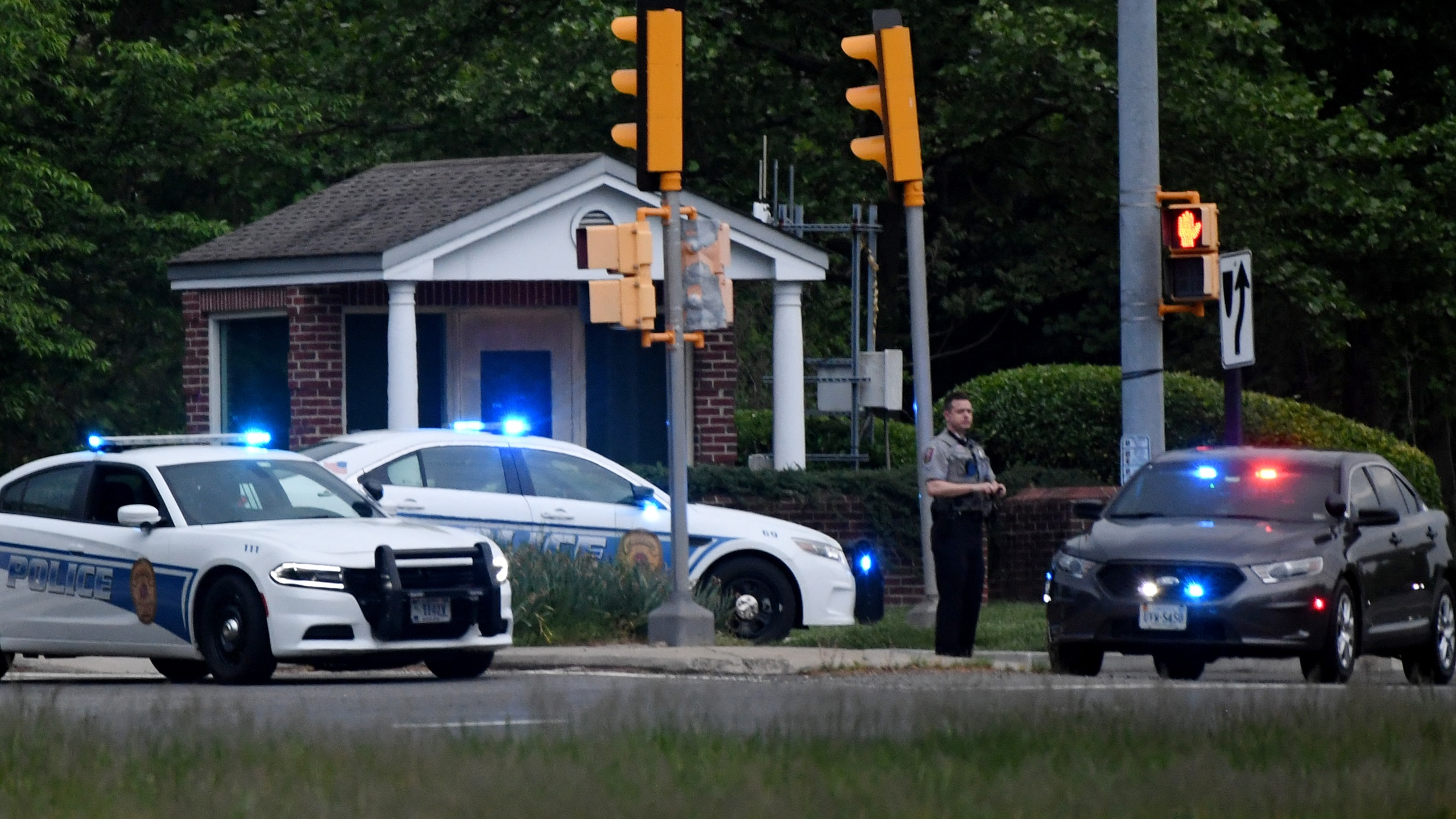 Police cars are seen outside the CIA headquarters' gate after an attempted intrusion earlier in the day in Langley, Virginia, on May 3, 2021. (Olivier Douliery / AFP / Getty Images)