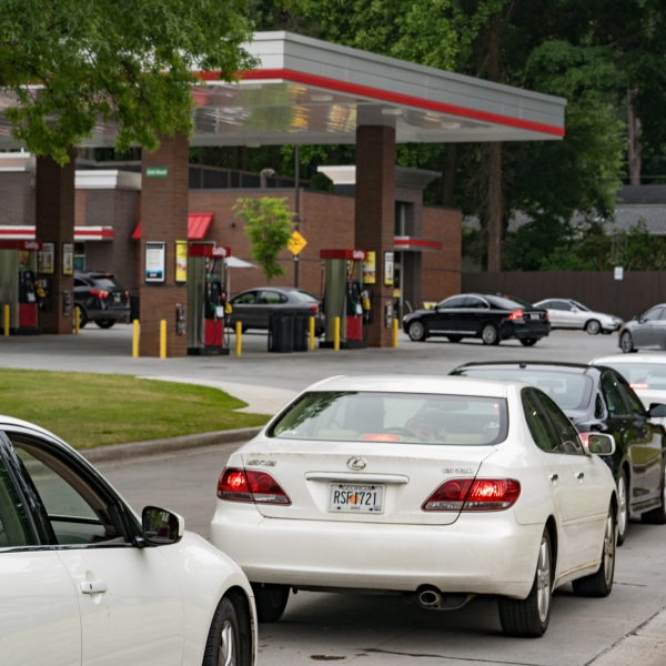 Cars line up at a QuickTrip gas station on May 11, 2021, in Atlanta, Ga. There is an expectation of a gasoline shortage in Georgia after Georgia-based gas company Colonial Pipeline reported a ransomware attack on May 7. (Megan Varner/Getty Images)