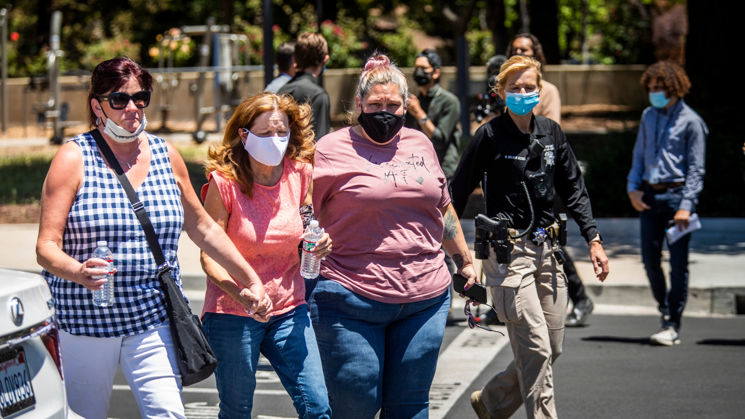 People leave a gathering point for family members and VTA employees on May 26, 2021, in San Jose, Calif. A VTA employee opened fire at the yard, with preliminary reports indicating nine people dead including the gunman. (Philip Pacheco/Getty Images)
