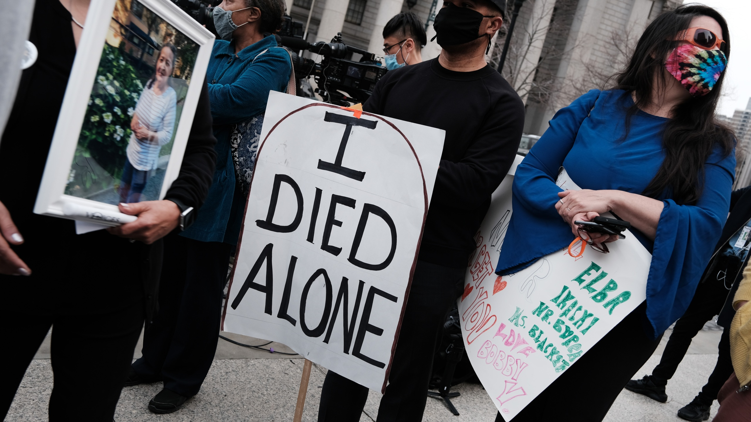 People who've lost loved ones due to COVID-19 while they were in New York nursing homes attend a protest and vigil on March 25, 2021 in New York City. ( Spencer Platt/Getty Images)