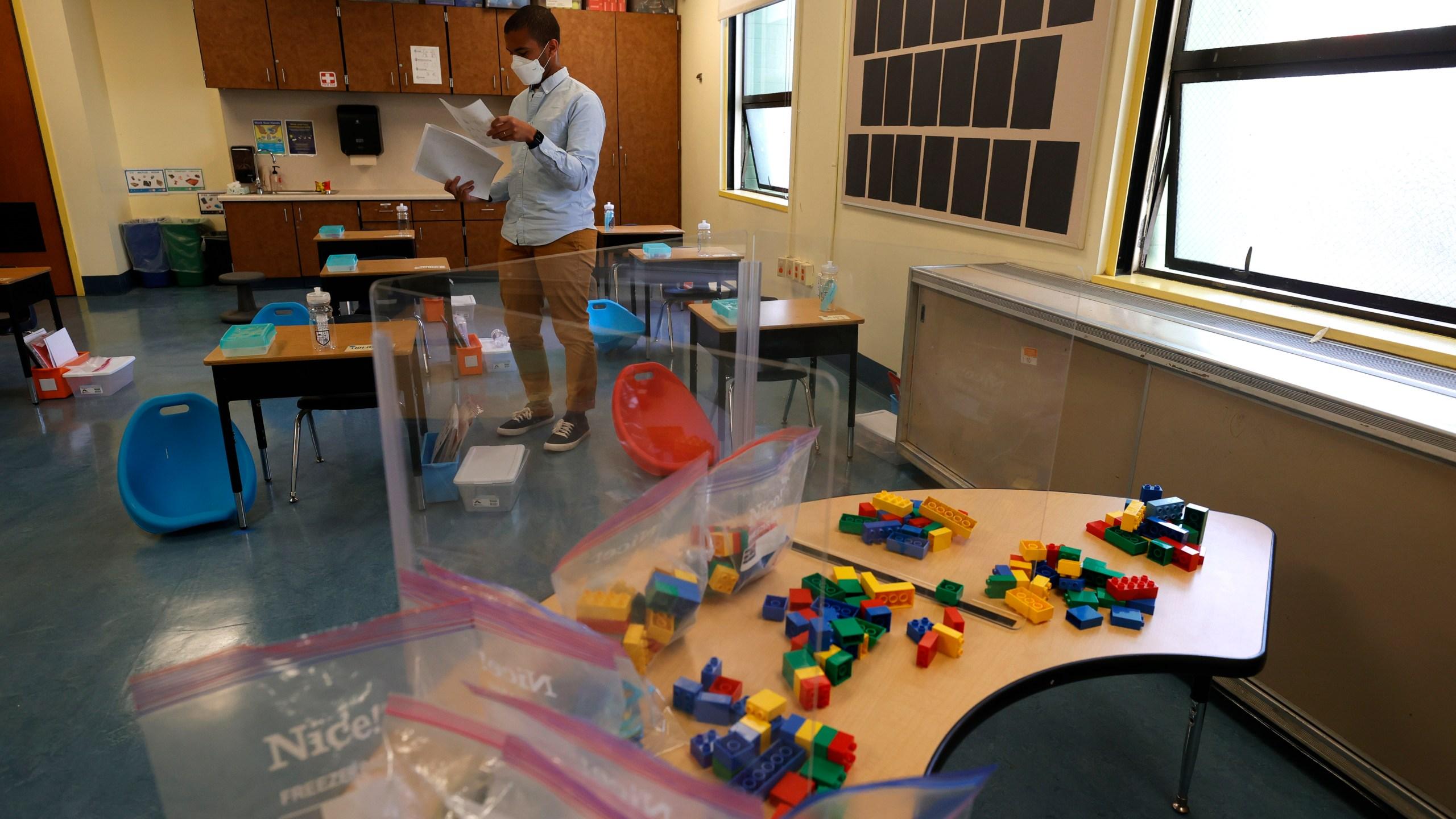 Bryant Elementary School kindergarten teacher Chris Johnson sets up his classroom on April 09, 2021 in San Francisco, California. (Justin Sullivan/Getty Images)