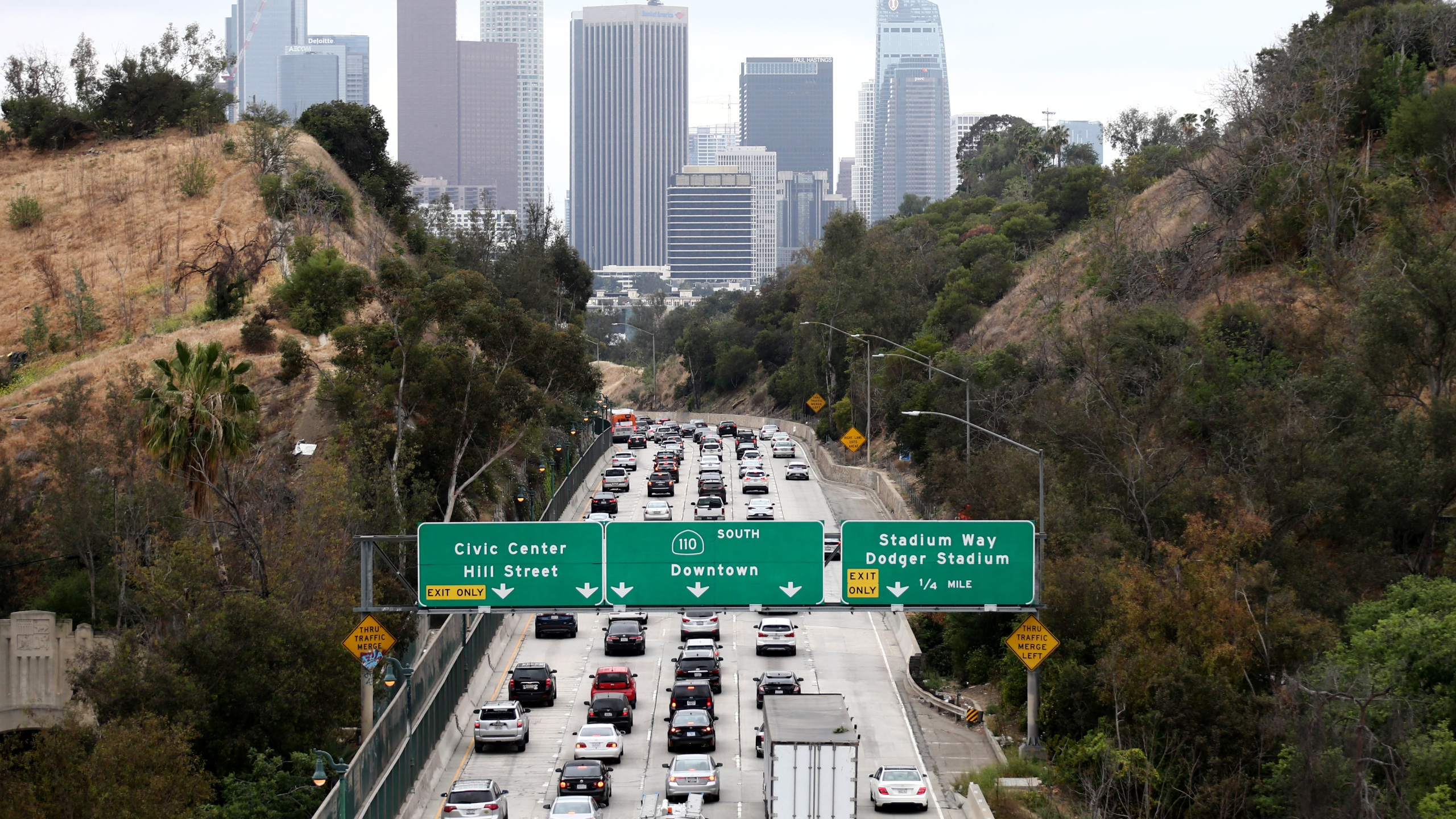 Cars make their way toward downtown L.A. on the 110 freeway during the morning commute on April 22, 2021 in Los Angeles, California. (Mario Tama/Getty Images)