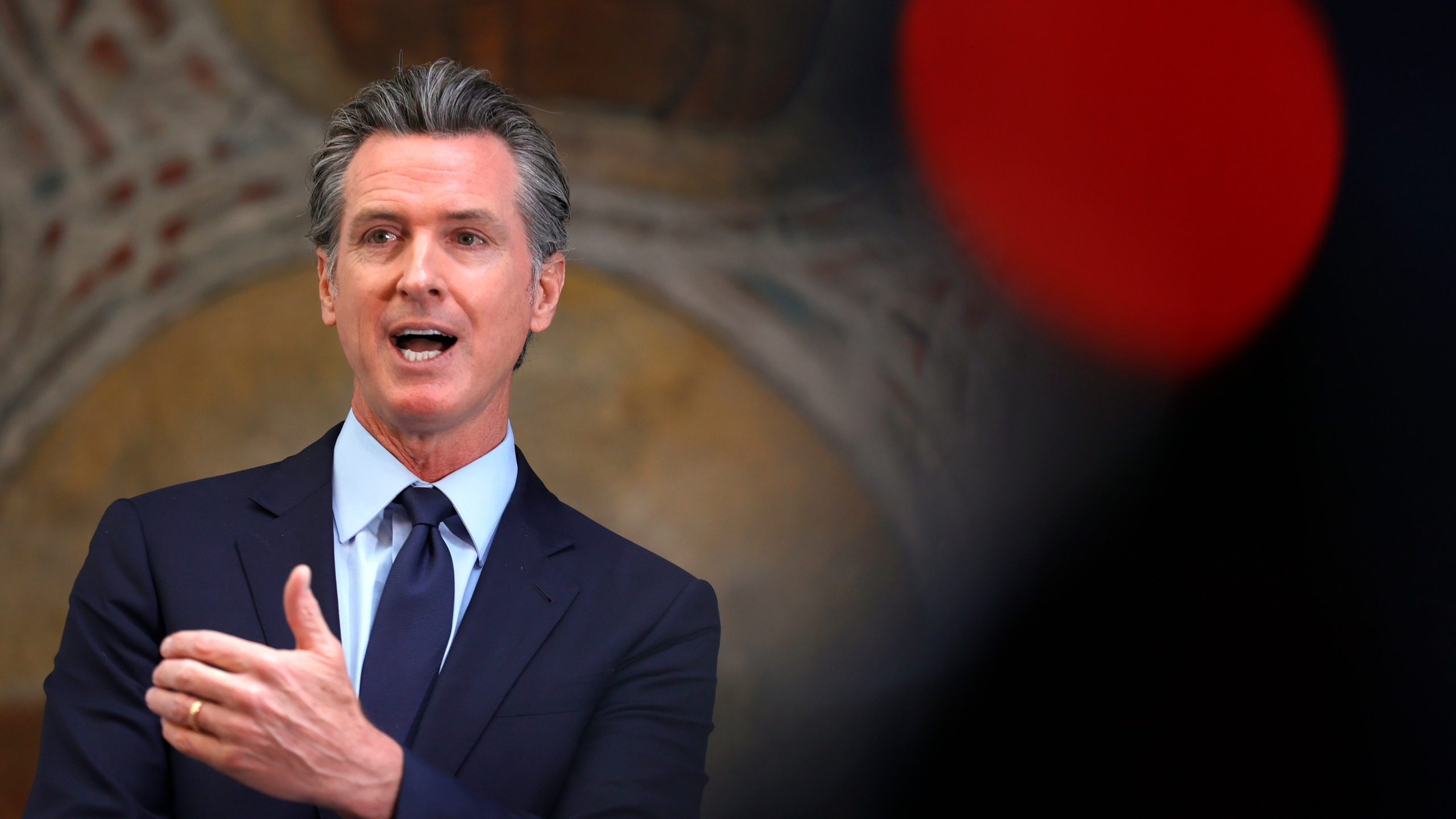 California Gov. Gavin Newsom speaks during a press conference at The Unity Council in Oakland on May 10, 2021. (Justin Sullivan / Getty Images)