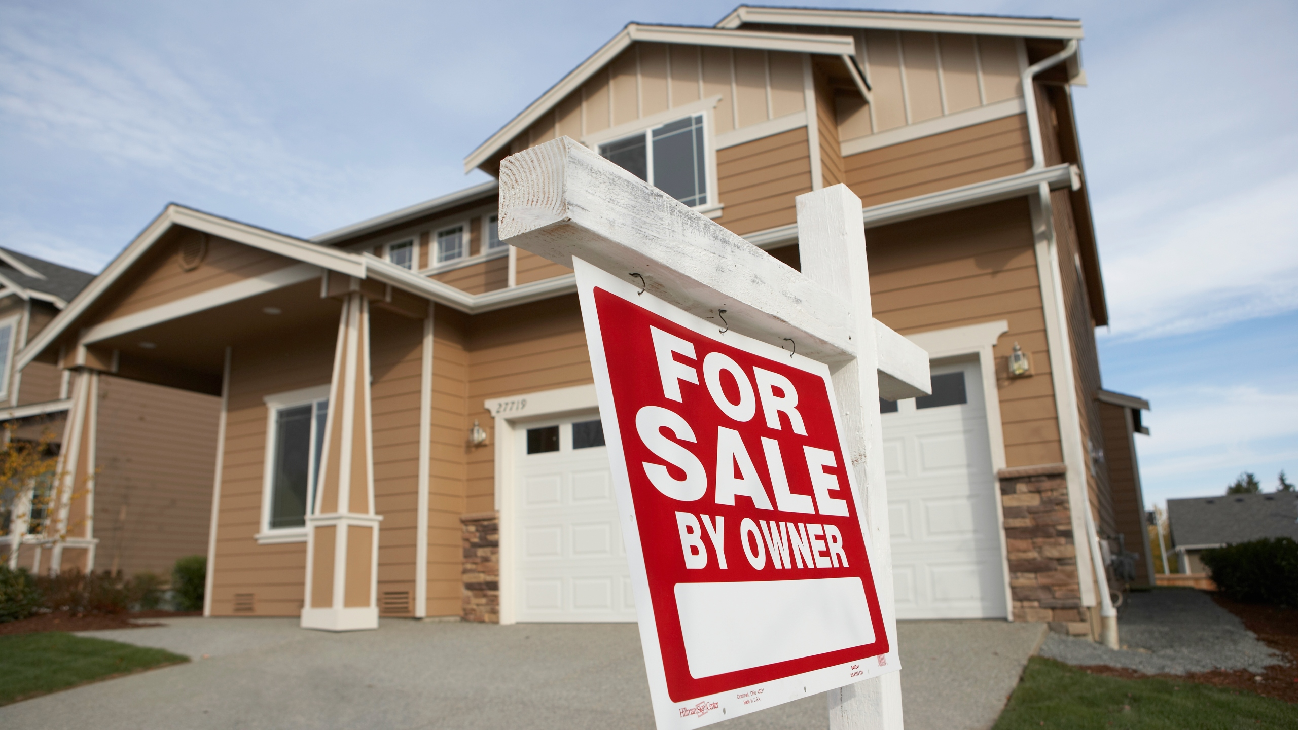 """A """"for sale"""" sign is seen outside a home in this undated file photo. (Getty Images)"""